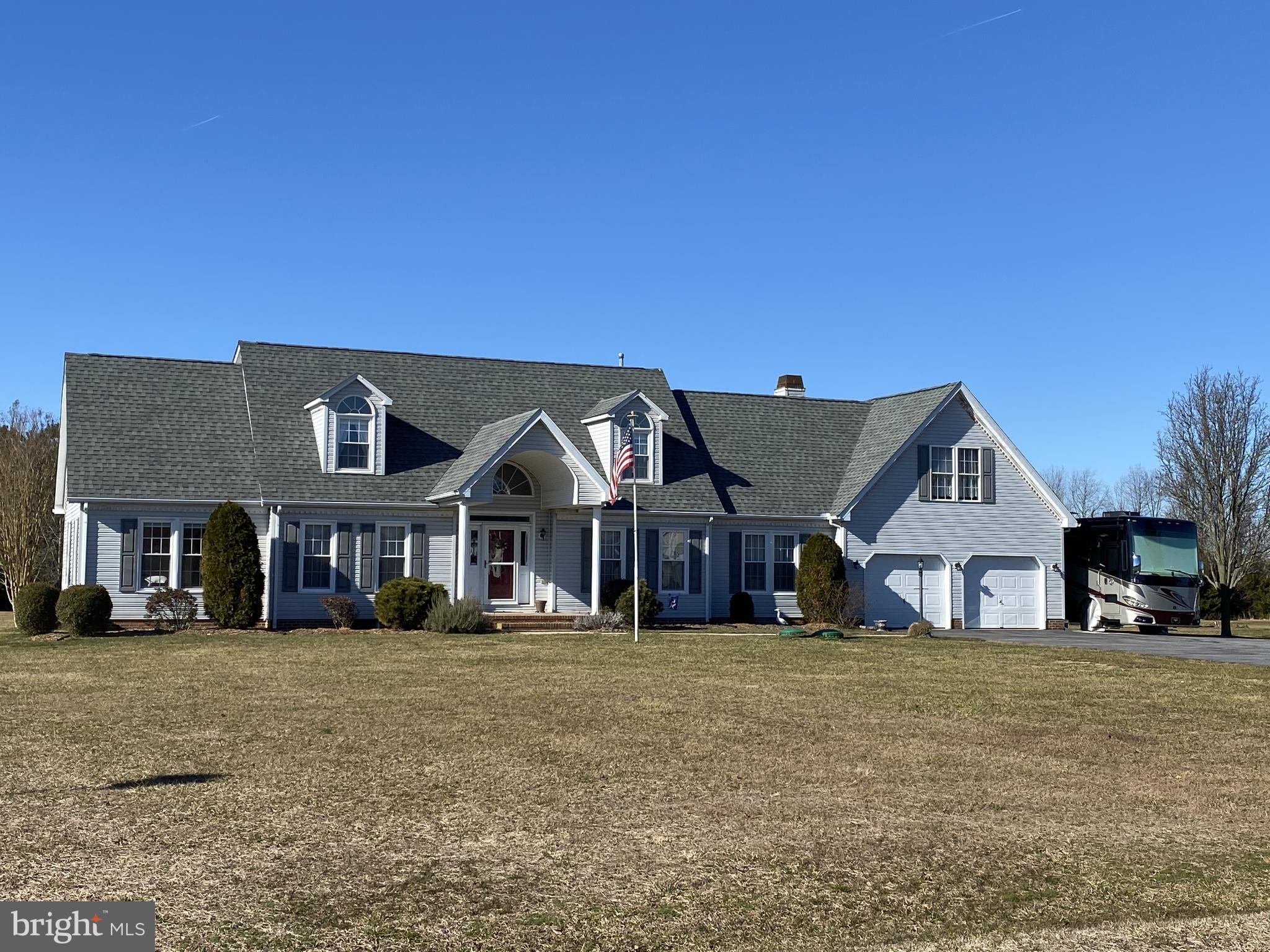 Hard to find home with these amenities on a one acre lot in a small neighborhood! Pride of ownership shows in this custom built 3185 sq ft Cape Cod home. Features include a formal living room, a dining room, eat in kitchen, family room, Florida room, two bonus rooms, basement with bilco door and 3 car garage on one gorgeous acre!  There is a first floor master bedroom that has two large walk in closets, a beautiful master bath with a large custom tiled shower with  built in seats both inside and outside the shower, tile flooring and two separate vanities and sinks. The family room has a cozy gas fireplace and pocket doors to close off the room. The kitchen has recessed lighting and tons of cabinets and counter space, great for entertaining! And there is a formal living room and dining room.  The upstairs floor plan features a unique layout with bonus rooms that are attached to each of the bedrooms, making a wonderful office, workout room, craft room, playroom or extra room for guests.  Also on this level is a floored walk in attic, great for storage. A favorite room of the house is sure to be the 21 x 15 Florida room with a vaulted ceiling that overlooks the large back yard. It opens to the 20 x 14 deck. The large driveway can easily hold 10 vehicles and RV's are allowed to be parked there. In addition to the attached two car garage, there is a separate garage with electric that could be used as a garage or awesome workshop. Home has beautiful custom colors throughout.  Includes a one year 2-10 Home Buyers Warranty for peace of mind. Great location close to DAFB, CR School District, shopping and easy access to RT 1. Nothing to do but move in!