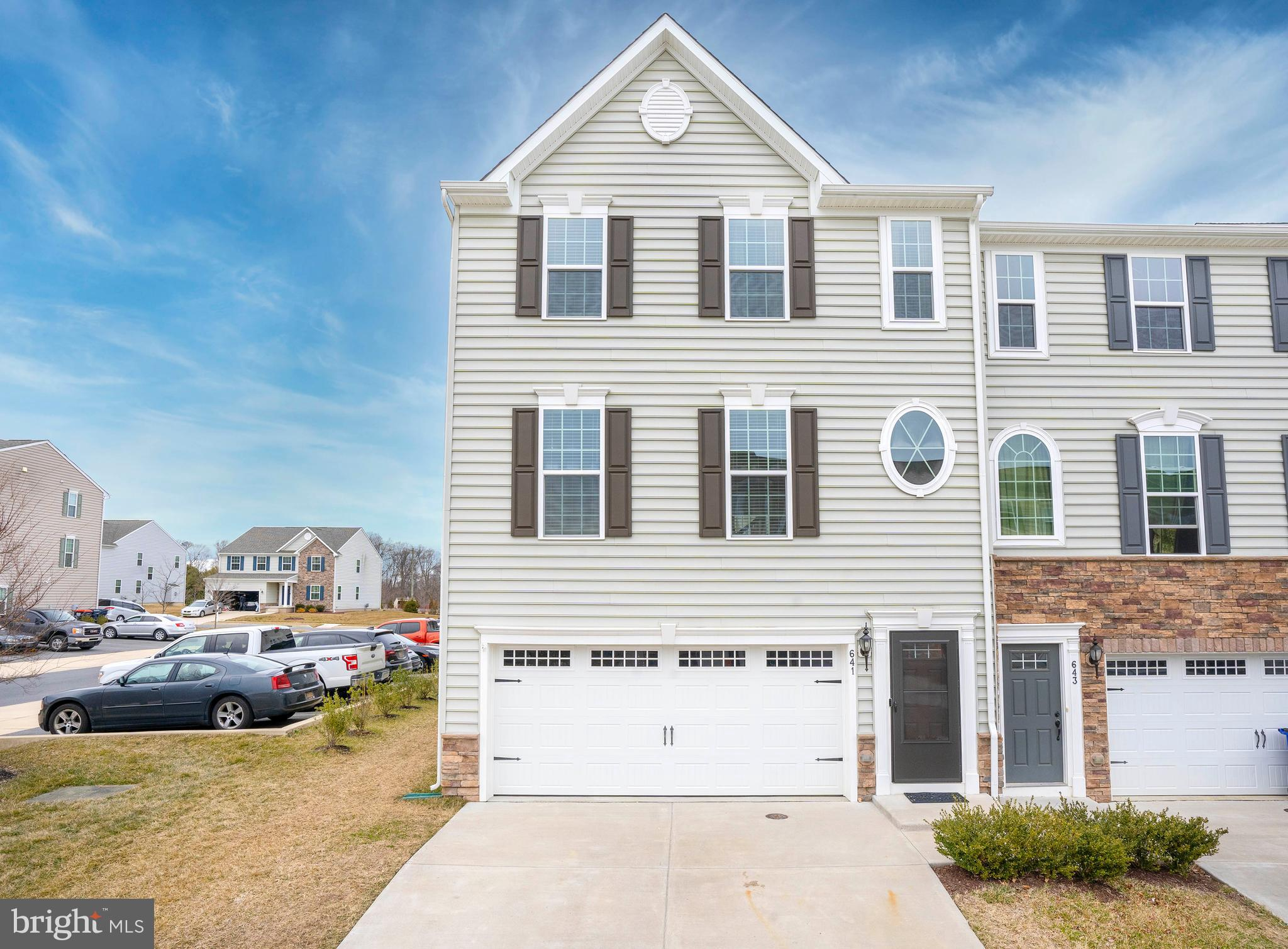 HIGH HOOK FARMS - LIKE NEW 3 Bedroom, 2.5 Bathroom End-Unit Townhouse in Middletown.  This meticulous property is located on a PREMIUM CORNER LOT & is within the highly-ranked APPOQUINIMINK SCHOOL DISTRICT.  Just built in August of 2017, this home is like new but without the wait!  Featuring 3 FLOORS OF LIVING SPACE & a 2-CAR GARAGE, this one should not be missed on your tour.  Head up the private driveway and enter the home into the 1st floor foyer.  On the first level you will find interior access to the garage and a spacious family room with direct walk-out access to the back yard.  Head up to the main level of the home where you will find beautiful hardwood floors that run throughout.  The kitchen features: GRANITE countertops, crown molding on cabinetry, an island, a pantry, recessed lights, a smart fridge, and STAINLESS-STEEL APPLIANCES (included!).  Completely open to the kitchen is the dining room which includes a built-in dry bar and a chandelier.  A door from the kitchen leads to the elevated 2nd story DECK, perfect for grilling and outdoor entertaining!  Back inside and also on the main level is a powder room.  Head to the upper level where you will find 3 bedrooms, 2 full baths & a 3rd FLOOR LAUNDRY CLOSET.  The Master Suite features a tray ceiling with crown molding, a WALK-IN CLOSET, and a 5-PIECE MASTER BATH.  The Master Bathroom boasts double sinks, a soaking tub, a shower, tile floors, and tile bath/shower surrounds with mosaic accents.  The two remaining bedrooms are of good size and a 2nd full bathroom can be found down the hall.  Other notable features include; Tankless Water Heater, 4 ft. Builder Bump Out in the rear, all appliances included, smart home Nest doorbell & Nest thermostat included.  Don't wait, call to schedule your tour today before it's too late!