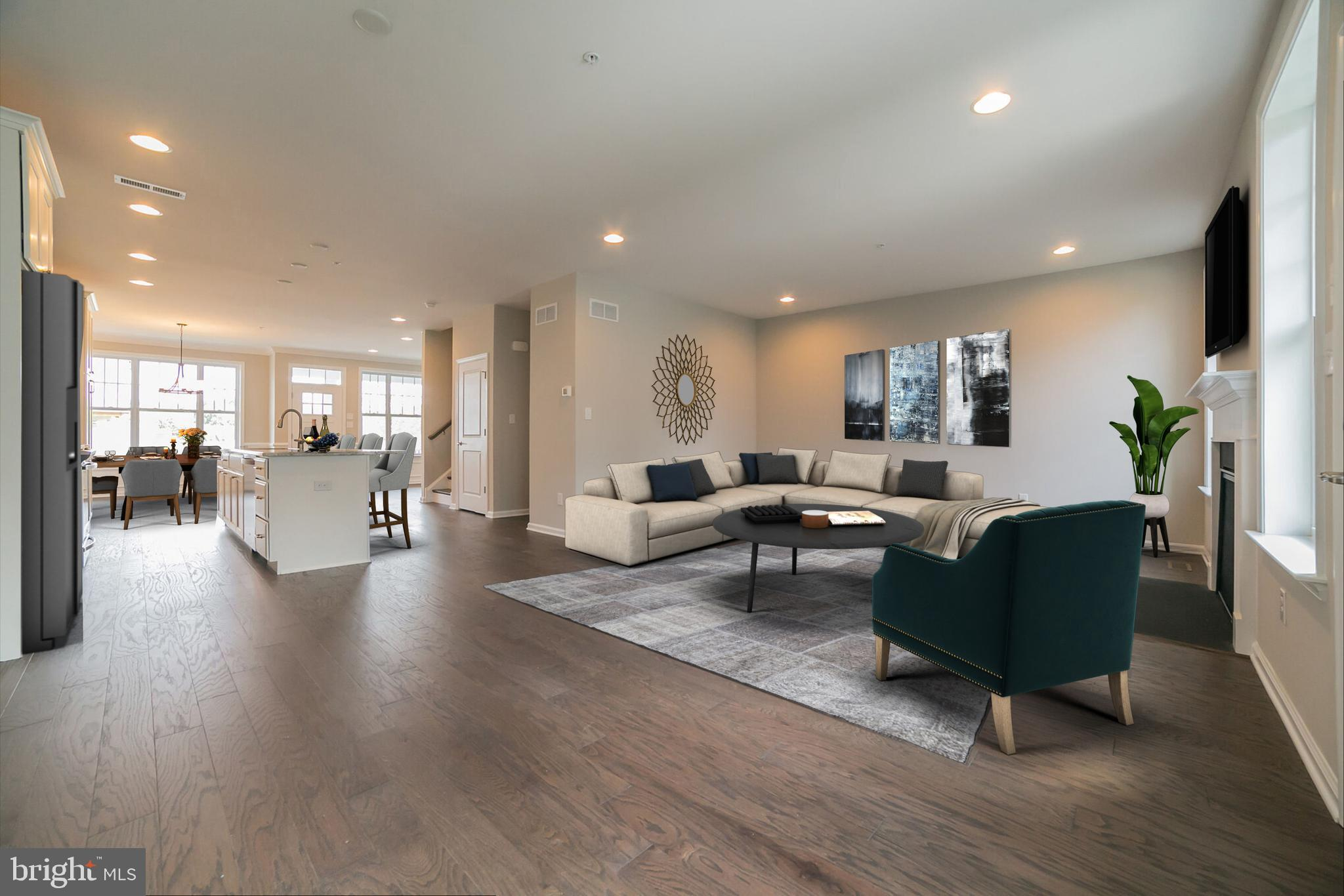 """2018 Synergy Award Winner for Best Energy Efficient Townhome & Best Community Clubhouse!  This flexible, open floor plan, our new Kingston V, is a 3 bedroom, 2 1/2 bath, 2-car detached garage.  Features 9' ceilings including a 9' poured foundation. The kitchen boasts granite counter tops, 42"""" cabinets and SS appliances. The large great room, separate breakfast nook, dining room and den/study complete the main living level. Enjoy the convenience of the 2nd floor laundry. Quality materials such as Hardie Plank siding on all sides and real window shutters depending on elevation.  Traditional Neighborhood Development (TND) promotes a sense of community not usually experienced in today's suburban developments.  Our design center will allow you to customize your home to your specific wants and needs. Spring Oak offers carefree living that has something for everyone; swimming pool, fitness center, walking trails, basketball court, community garden and 2018 Synergy Award winning Best Community Clubhouse.  Photos may vary from home. Price is based on time of deposit and contract within the required period of time.  Prices and terms of sale subject to change without notice.  Contact the Sales Office with any questions or to schedule a showing.  The Sales Office is open Monday-Saturday 10-5 and Sunday 12-5."""