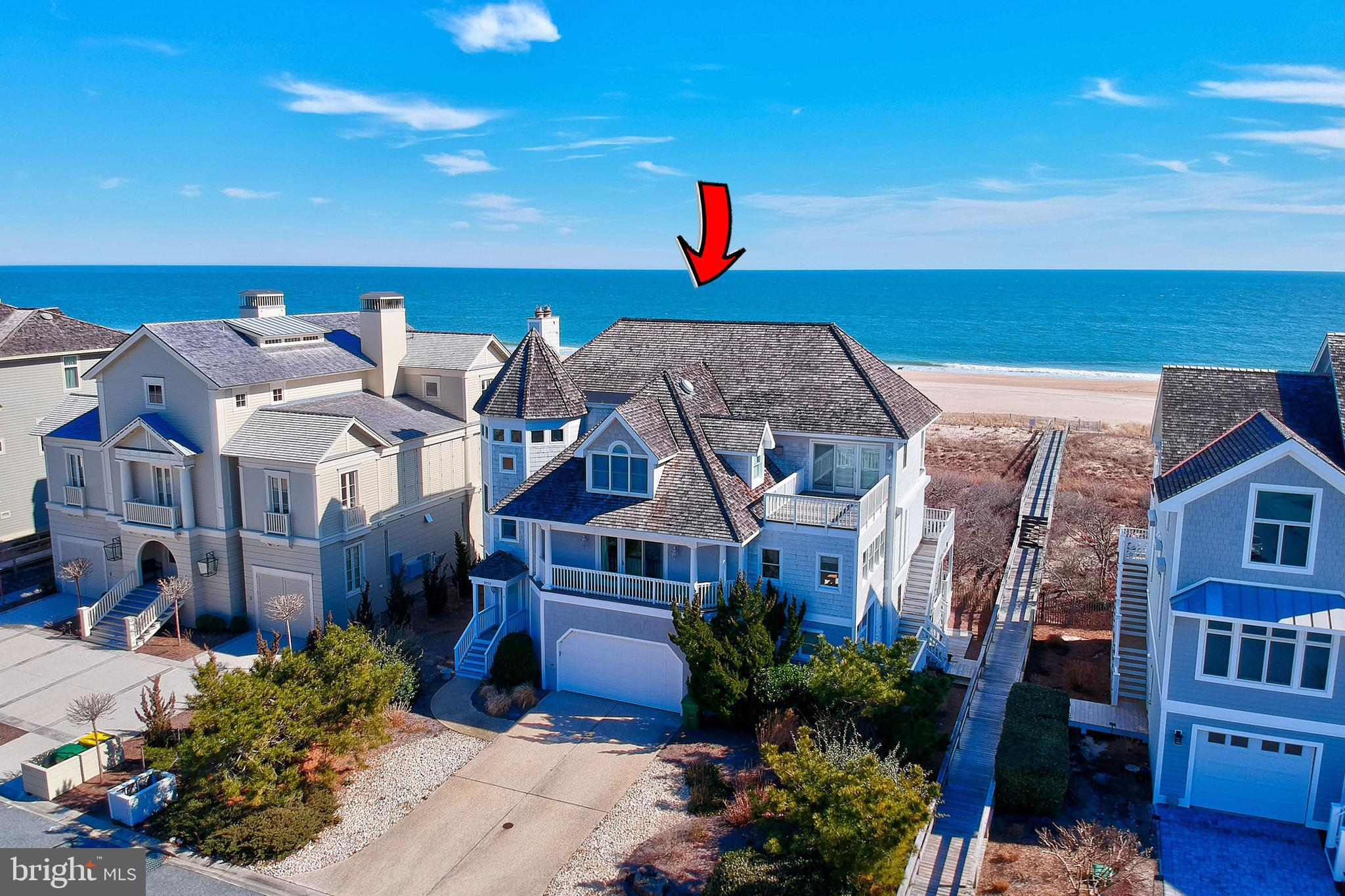 North Bethany OCEAN FRONT home located on a 75 foot lot in gated community with Pool.  A stunning spiral staircase leads you to a second floor open great room, with dining area, multiple sitting areas & panoramic ocean views!  Enjoy working remotely from your large home office with ocean views.  This gem offers direct access to private beach, Gourmet kitchen, elevator, 3 gas fireplaces,  oversized screen porch & multiple decks overlooking the ocean,   master bedroom with  private deck for you to watch the sun rise & sunset,  ALL bedrooms have private full baths.  The ground level has two wonderful ocean front bedrooms, family room & game area, wet bar & fireplace.  This community offers a community pool and is with in walking distance to the town of Bethany Beach.