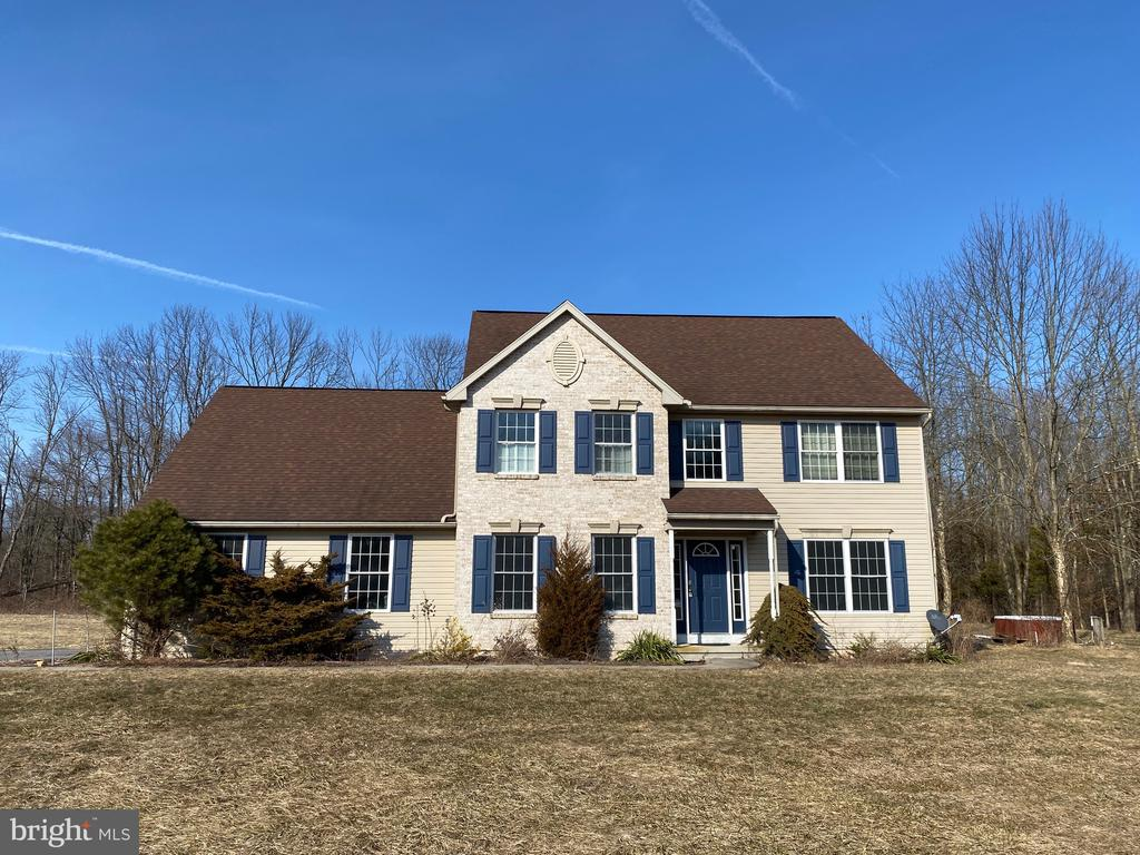 """Coming Soon! Expected on market date 3/29 Looking for a cosmetic fixer-upper? Here's your chance to make this house your own on 3.5 acres!  The huge detached garage is perfect for someone who needs space for their business equipment, home gym, hobbies, etc. Large 2,800+ sq ft Colonial home with 4 bedrooms 2.5baths and a large basement waiting to be finished! Being sold """"AS-IS"""" but the seller has added NEW HVAC & WATER HEATER (2020). Property is on Septic & Well water."""