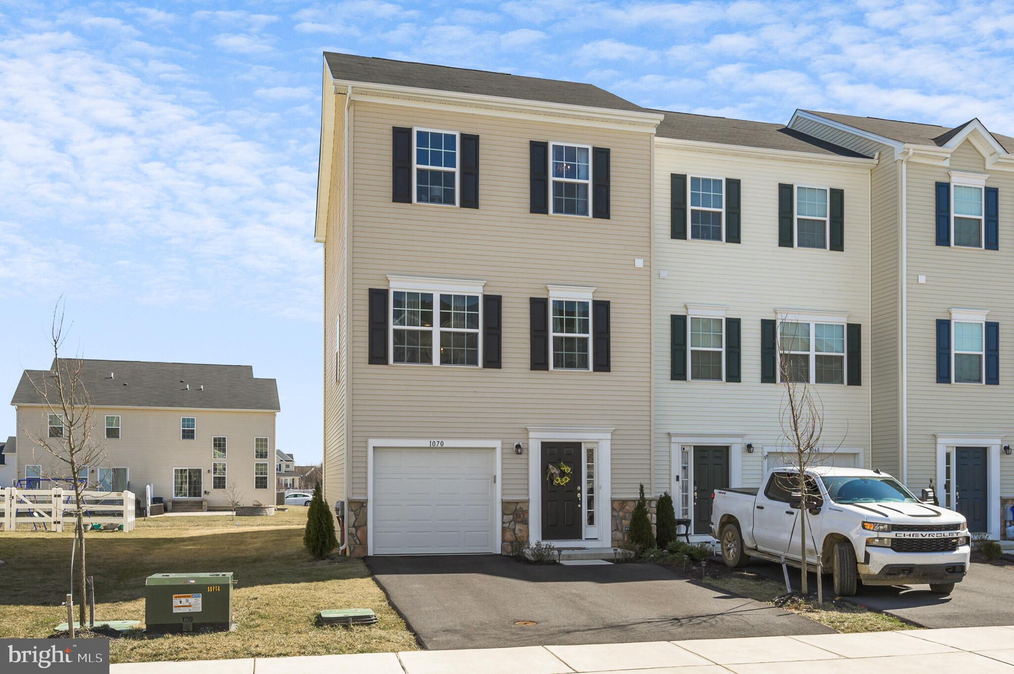 BETTER THAN NEW! WHY WAIT FOR NEW CONSTRUCTION! 1070 Wickersham Way already has upgrades included and is ready to be yours without the wait time of a new build! This gorgeous two year old, end unit, 3-story town home is in exceptional condition. Located in Hyett's Crossing and conveniently located within minutes of route 1 access, just south of the canal. Multiple upgrades have been added including the three story bump out which gives you an additional 11 x 10 feet on all levels. As you enter the home through the foyer, you will find the finished rec room which is perfect for entertaining guests. There is a sliding door that leads to a beautiful paved patio and spacious backyard. As you make your way upstairs, you will find the open concept living area complete with living room, kitchen, dining area, and breakfast nook. You will also notice the beautiful hardwood floors throughout the main level. The eye catching kitchen offers you granite countertops, stainless steel appliances and a 7-foot island with plenty of storage! There is also a powder room conveniently located on the main level. On the top level, you will find the master bed room with a walk in closet and sitting room. In the master bath you will find a dual vanity and the upgraded walk in shower with dual shower heads. 2 additional bedrooms, a hall bath and linen closet complete top level. With lots of features and upgrades this home won't last. Come out today before it's SOLD!