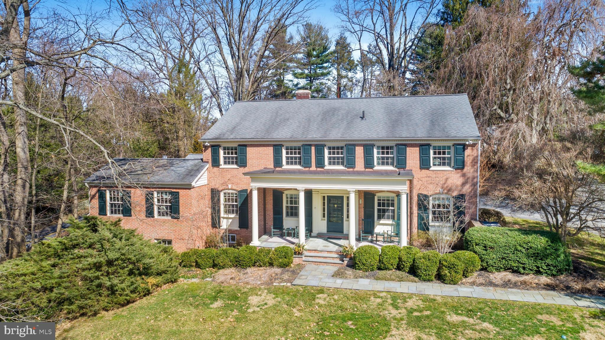 This 5 BD, 4/2 BA solid brick colonial has been beautifully updated and offers great, flexible living space! Significant improvements include a large FIRST floor Master Bedroom suite addition with a 3rd fireplace, sitting room, wet bar with beverage frig, private deck (with foundation & electricity in place for a hot tub), Master BA, walk-in closet, and spacious main floor Laundry Room. The totally renovated Kitchen has neutral white cabinets, stainless appliances, gas range with built-in exhaust hood, and a Breakfast Bar. It overlooks the vaulted Family Room with gas fireplace (which could also be used as a large Breakfast Room.) Enjoy gorgeous sunsets from the southern-style covered front porch or al fresco dining on the rear flagstone patio! Center Entrance Hall opens to Living Room with built-ins and a wood-burning fireplace and to the very private 1st Floor Den/Office with Powder Room. Gracious, centrally located Dining Room. Upstairs is a SECOND Master Bedroom suite with 2 large closets and en suite full BA. Bedroom 3 also has its own full BA. Bedrooms 4 and 5 share the Jack n Jill 4th full BA. All Bathrooms are neutral and updated. With master bedrooms on both levels, this home works well for multi-generational families. Downstairs is an expanded, large basement with rooms for TV watching, game tables, exercise, a 2nd Half BA, and 2nd laundry/utility/storage. Great closet space abounds, plus there is additional storage in the floored attic and in the attached 2-car garage. Pride of ownership is evident in this meticulously maintained and updated home! The quiet, cul-de-sac street has access to tranquil grounds with a scenic pond and walking paths on the campus of a nearby school. Located near downtown Bryn Mawr, this home is also close to train stations, Bryn Mawr Hospital, Villanova University, movies, shops and restaurants. Easy access to corporate centers, Blue Route, Center City, and Airport. * * * Please note that Delaware County is conducting a real est