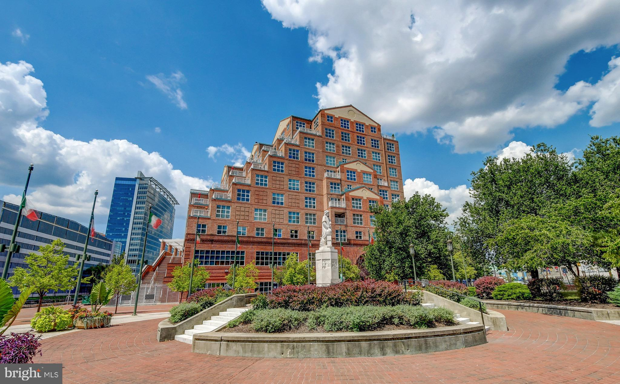 Beautifully remodeled 2 bedroom condo with neutral decor and rich hardwood flooring throughout.  The open floorpan allows for sun filled rooms in all living areas and both bedrooms.  Simply remarkable!  Located in Scarlett Place in the perfect location where The Inner Harbor Harbor East and Little Italy converge - this is a dream for anyone who wants to sample hundreds of restaurants within a short walking distance.  Secure gated parking is also included. A recently remodeled home in the heart of everything going on in the city at a very attractive price - what else could anyone ask for?