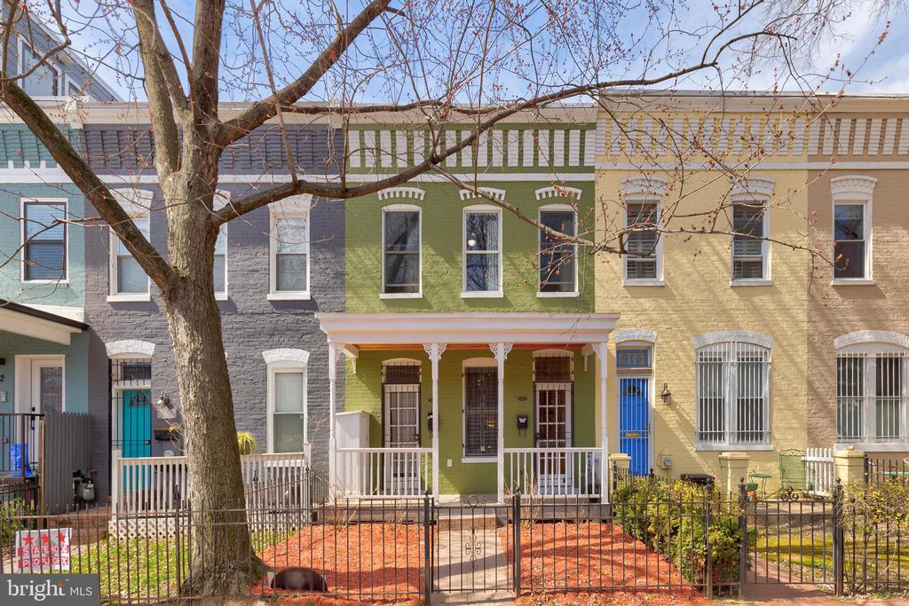 """Investment property offering! Completely gutted and rebuilt legal two-unit townhouse with CofO, including new roof, in 2003-2004. Further owner improvements over the years including new Carrier HVAC units in 2020, new stacked washers and dryers in 2019/2020, new stainless steel appliances in 2020, ceiling in lower unit with sound-proofing fiberglass insulation, sound-absorbing 5/8"""" drywall and """"U channels"""" suspended from the joists diminish noise, and more! A true turn key income producing property lovingly restored by the owner. The home features an expansive lot with real TWO car off-street parking. Upper Unit: Gleaming hardwood floors, high ceilings, decorative fireplace, large open living room overlooking picturesque tree-lined 9th ST, modern kitchen with glass tile backsplash and high-end cabinetry, great bedroom with ample storage, well appointed bathroom, in-unit laundry, and deck off the unit completing this home. Main floor Unit: Gleaming hardwood floors, equally high ceilings, decorative fireplace, large open living room with shutters, modern kitchen with glass tile backsplash and high-end cabinetry, great bedroom with ample storage, well appointed bathroom, and patio off the bedroom completing this home. Located in the heart of H ST NE, with Whole Foods, Trader Joes, fine dining from Capitol Hill to H ST to Union Market, and NoMa redline metro. Please contact listing agents for rent roll figures."""