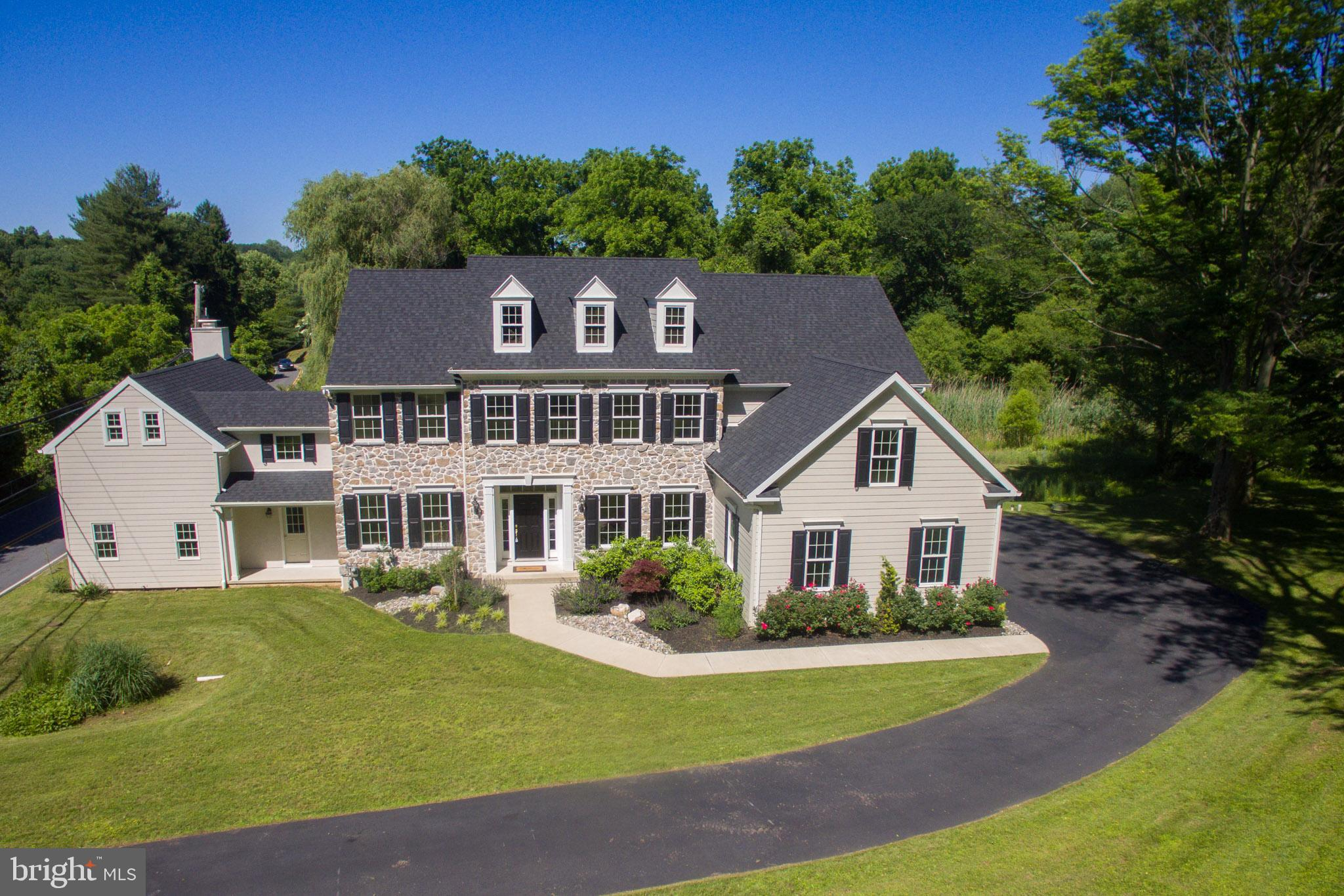 A spectacular, exquisitely executed custom built home preserving the charm of a 138 year old farmhouse while offering generous luxurious amenities of new construction. The majestic, distinguished exterior is accomplished by a striking stone front, accented by hardi plank siding. A premier location delivers access to the top-rated TE schools & close proximity to the Paoli train, all major routes, Chester Valley Trail, historic Valley Forge Park, the King of Prussia Mall plus diverse shops & restaurants of the Main Line. A grand entry foyer has hardwood floors, a turned center staircase & ample natural light afforded by its open flow into the formal living room on the left and the formal dining room on the right. You'll love the gourmet kitchen with high-end granite counters, maple cream color cabinets with soft-close drawers & doors, a center island with contrasting cherry chocolate finish, Bosch stainless steel appliances, and a 2-story dining area adjacent to a nice sunroom with cathedral ceiling & access to the yard. There's also a large walk-in pantry just off the kitchen. The family room has a gas fireplace flanked by large circle top windows. There are 9 ft ceilings on the 1st level, and a powder room, laundry & office. Retreat to your restful master suite with separate sitting area & a massive walk-in closet with his & her entry & 2 skylights. The tastefully stylish master bath has a double-bowl vanity with Carrera marble vanity top, a walk-in shower with frameless glass shower door & coordinating Carrera tiles that wrap around the luxurious soaking tub. 2 of the 3 additional bedrooms share a Jack & Jill bath with a comfort height vanity with unhoned Carrera marble top, 12x12 ceramic tile floor coordinating with the walk-in shower floor & walls, and a linen closet. The hall bath has a comfort height vanity with unhoned Carrera marble top and 12x12 marble floors that coordinate with the walk in shower. A nice size landing on this level is pre-wired for cable, m