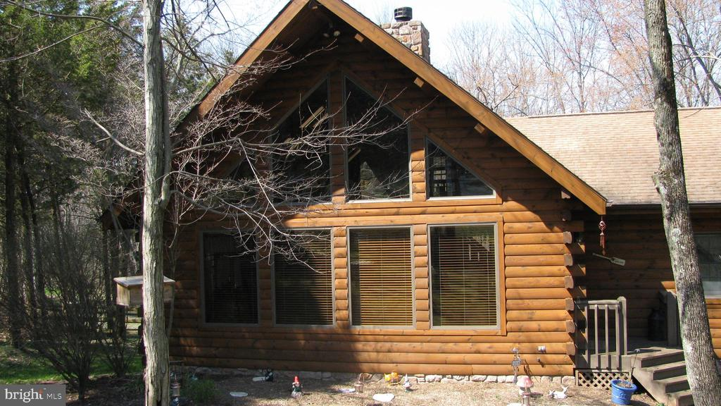 Family Dream comes true - This beautiful, custom-built Kuhns Brothers Log home situated on 1 acre with a massive living room featuring a floor to ceiling stone fireplace, 2+ bedrooms, 2 full baths, Loft,finished basement with woodstove in the large family room and 2 large additional rooms. Atotal of2500+ square feet of living space with an attached large 2 car garage is waiting for you. This property is in beautiful Montgomery County, PA with low taxes! This one goes out to all Animal lovers with a large fenced in backyard for your dogs to run free and a Catio for our feline friends to sunbathe and bird watch. Enjoy the amazing coziness of not one, but 2 wood-burning fireplaces (one stove) detailed with natural stone face in the living room and family room.Spend quiet evenings sitting on your deck under your gazebo overlooking your beautiful backyard and listening to the sound of the water flowing from the creek.Only a 25 minute commute to King of Prussia. This is a rare find for this area, a Must See!
