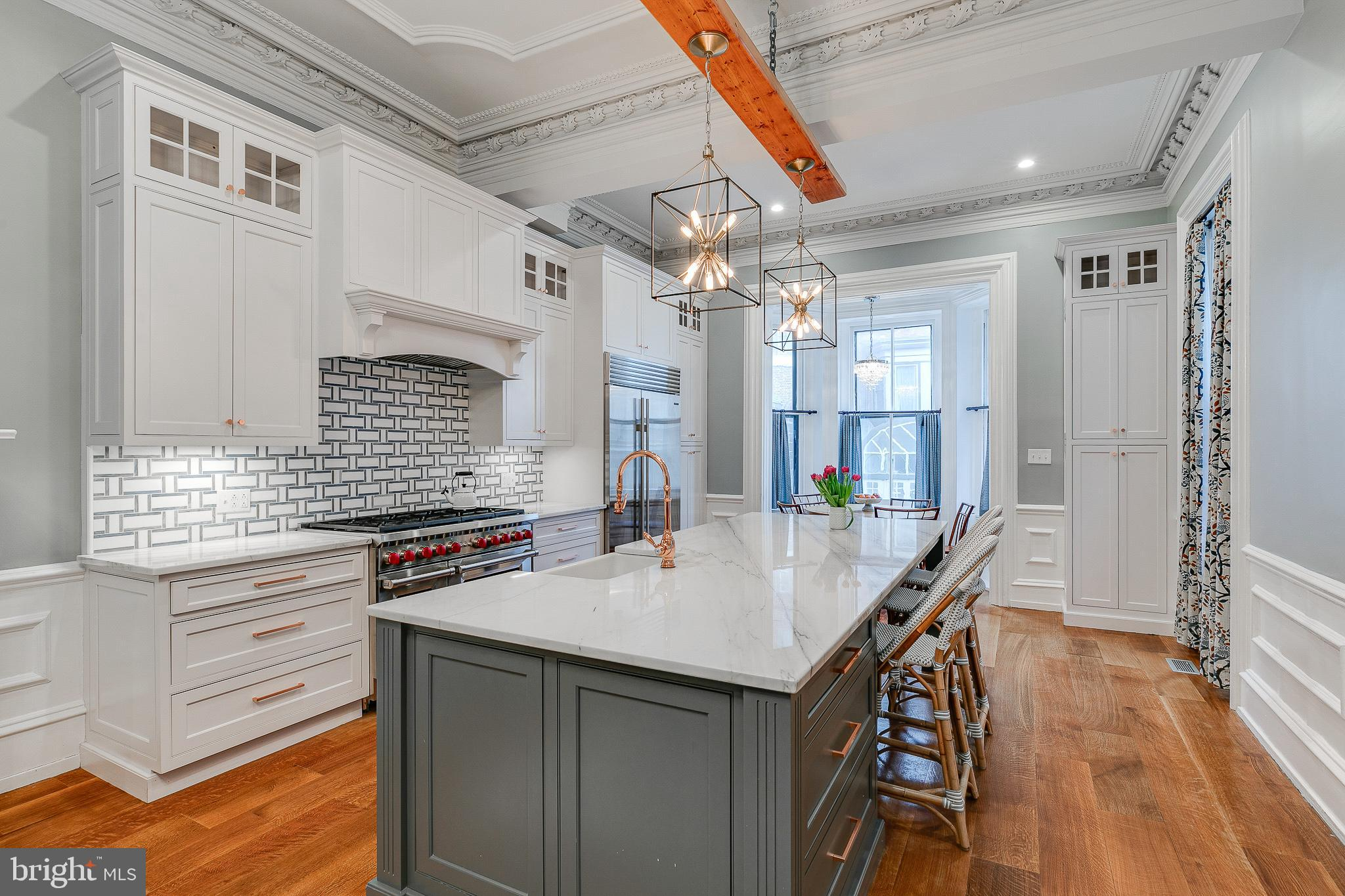 """Situated on one of Rittenhouse Square's most iconic blocks sits 2022 Spruce Street a 22x120, 5900 sq ft, single-family townhouse. Constructed in 1752, the sun-filled Federal-style home is replete with original detail and charm that makes townhouse living so sought after. Amenities include two car parking, grand salon, six bedrooms, abundant closet space, three fireplaces, and original detail throughout. There is a first floor rear rental unit that may be accessed from the main residence for use as a guest apartment or separate outside access for an income-producing investment. The 2nd floor rear has been transformed a chef's kitchen that will delight entertainers with its spacious island, stone countertops and high-end inclusions, plus there is a separate sitting area with fireplace and home management built ins. The entire Townhouse is graced with lavish detail throughout. This Majestic Mansion boasts the most important and sought-after location in the city. Steps from Rittenhouse Square and neighborhood shopping and Philadelphia Museums and the Arts.  LAYOUT:  LOWER LEVEL: Unfinished with storage and mechanicals  GROUND FLOOR: Entrance vestibule. Magnificent reception hall and elegant formal stairway with an extraordinary staircase and banister. Grand Salon with fireplace. Powder room. Separate guest suite currently used as an income unit. Access to 2 Car Parking.  PARLOR FLOOR: Unusually wide landing which is currently used as the dining room. Formal living room with fireplace. South-facing custom Kitchen with 12' 6"""" ceiling height with ornate plaster moldings throughout. Breakfast area and large sitting room. Powder room.  THIRD FLOOR: Front: Primary suite with fireplace. Dressing room and oversized bath with Sauna. Rear: Bedroom, Playroom/Sitting room and en-suite bath  FOURTH FLOOR: 3 bedrooms and shared Bath"""