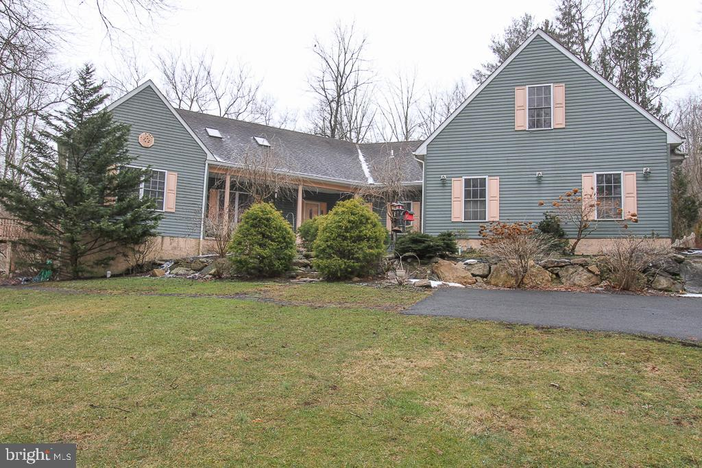 Tucked away in the rolling hills of Earl Township Berks county.  This is a very unique one floor living custom built home situated on 1.52 acres with peace and quiet, wildlife, nature, and a place for relaxation.    The property offers a picturesque view.  As you come into the front door you are greeted with the heart of the home.  Step into the large open concept kitchen, dining room, living room.  The kitchen features granite countertops, w/ bar seating, double wall oven, beautiful cabinetry,  and  dining area.  There's a clear view to the living room which allows you to watch TV or enjoy a wood burning fire as you make dinner. The living room has an amazing stone built wood burning fireplace.  A  3 season room is located in the rear of the house with access from this area. On the far side behind the living area is a bedroom area.  This area offers a bedroom, full bathroom, and a 2nd bedroom with a sliding door leading to a deck.  The 2nd bedroom walls are sound proof so you will never hear any noise coming from the heart of the home. This area has its own heating zone.     Heading back through the main living area and down the hallway you will come upon the master suite.  This suite is tucked behind the kitchen and again the walls are soundproof.  The oversized bedroom area offers a small office space, 2 separate closets, and an on suite bathroom.   Lovely sliding door that leads outside to a backyard patio with a Sun setter awning.  Master Suite has it's own heating zone. The main hallway offers a large pantry,  full bathroom, laundry room, and ample closets.   At the end of the hallway is access to the garage, basement, and loft suite.   We will continue by heading upstairs to the loft suite.  In this area of the house you will find a large and space that provides many opportunities.   You have a comfortable living space and kitchenette area, a full bathroom, and a large bedroom.  This loft suite has its own heating and cooling  zone.   Going down to the baseme