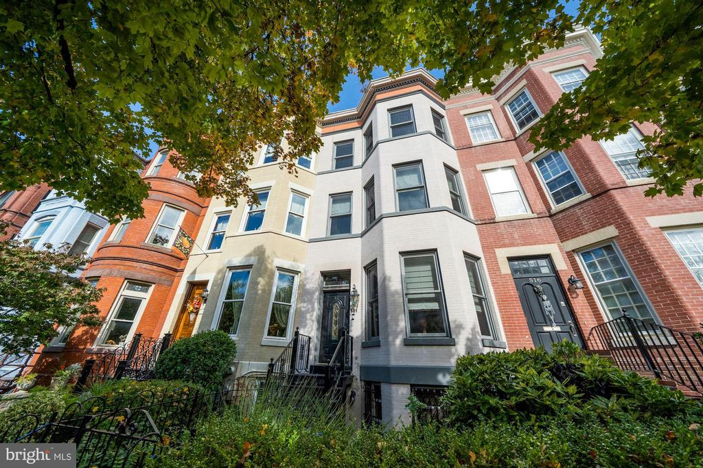 New Price! Seward Square Victorian in the hub of Capitol Hill. Can't beat this location! Near Pennsylvania Ave., the Capitol, Library of Congress, Eastern Market, & Metro.  The upper levels (3) are sun-drenched with multi-tiered skylights and overlooks to lower levels. Brick wall backdrop spans 3 levels and is calling out for art pieces. A contemporary renovation with classic touches including a main level parlor with glass doors. The main level is open for entertaining and includes a wine room that opens to an enclosed screened  porch and a private oasis including a stone patio and an outdoor fireplace. Upstairs is a state of the art eat-in kitchen, large dining room and bar area and a bedroom with sitting room and full bath. Up one more level is a primary bedroom retreat with magnificent views, spa bath with soaking tub and shower and a dressing area,  walk-in closet and washer/dryer.  The lower level suite has two entrances and includes a bedroom and den, full bath, living room, updated stainless/granite kitchen and separate washer and dryer. The front courtyard is brick and fenced.