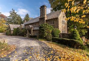 A beautiful Walter Durham inspired 'English Country Estate home' of more than 8000 sq ft with a slate roof, original stone walls, and copper gutters, within  a peaceful and secluded 4+ acres of land behind automated gates, on this prestigious street of just 5 homes in the heart of Villanova. The interior is to be meticulously refurbished  and, in some areas, professionally  redesigned by a reputable Main line builder specializing in period and historic renovations. Rest assured,  the interior will be finished with current 'high end' finishes throughout, including kitchen and bathroom renovations using a local artisan custom cabinet maker, new utilities and appliances, including generator. The bedrooms upstairs will be reconfigured to create 5 full beds, including a master suite with balcony overlooking the grounds, and 4 full baths. As well as 2 powder rooms. There will be  a huge bonus room over 3 of the 5 car garages and a finished basement The magnificent cathedral height family room with exposed timber, sits adjacent to the gourmet kitchen, along with a breakfast area , and formal dining room.  The formal sitting room with elegant stone fireplace opens out onto a side patio adjacent to a paneled library/study  with its own fireplace. There's a fabulous inground pool, with built in hot tub, waterfall and  views  of the creek below.   - accessed from the elegant stone walled patio at the rear. The property sits in an elevated position overlooking the extensive grounds. Encourage your  clients  to check us out soon, so that they have the opportunity to become involved in making  some of their own choices to enjoy a custom renovation. Please see commission schedule in Agent remarks