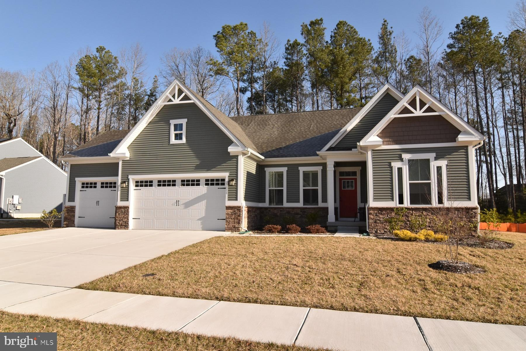Spring is in the air! Beautiful Spring Haven model home with almost 4000 square feet of luxury! Located in the sought community of  Spring Breeze!  Better than new with all the upgrades. Top elevation w/ stone front, 3 car garage w/ insulation, finished basement with full bath, irrigation system with separate well, custom window treatments, just painted,  gutter guards, plus much more. Gorgeous gourmet kitchen w/ extended granite center island and extended granite counters, stainless steel appliances, pantry.  LVP in the living areas. The Spring Breeze community is a secluded wooded community minutes from Lewes and Rehoboth Beach featuring an outdoor pool and low HOA fees. Minutes to 5 shopping centers! Don't let this one get away!