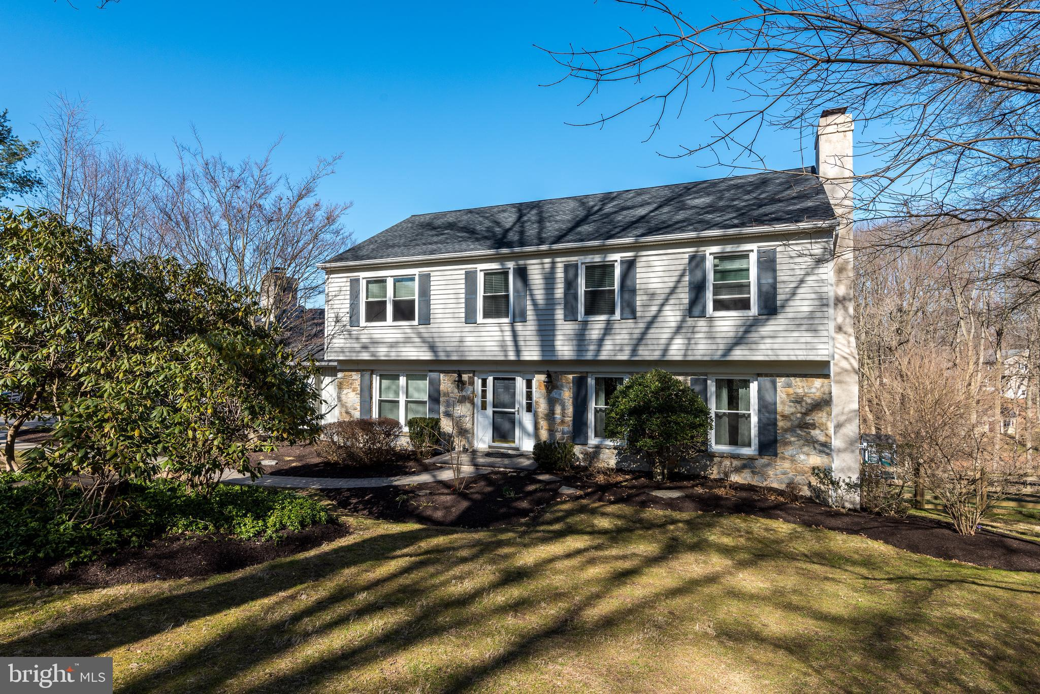 Showings begin Saturday 3/27 for this fabulous home in sought after Red Bridge Farm! This beautifully maintained, wonderfully updated colonial with stone and siding exterior is nestled on a full acre lot with spectacular wooded views. With neutral décor throughout, this home is move-in ready. A paver walkway brings you to the front door, which opens to a welcoming foyer. To the right of the foyer is a large living room with crown molding and one of two gas fireplaces. To the left of the foyer is an office/study, ever so useful in today's world. Straight ahead is the kitchen, the heart of the home. Featuring beadboard wainscoting, cherry cabinetry, granite counters, stainless Steel appliances and a contrasting island with cream cabinetry, you'll love cooking and entertaining in this great space. Glass doors from the breakfast area lead to an oversized, tiered composite deck that overlooks the expansive backyard with beautiful views all year round. To the left of the kitchen is the dining room accented with chair rail and crown molding with plenty of room to host your favorite guests. A few steps from the other side of the kitchen is the wonderfully large family room with a brick surround gas fireplace and picture window to the outside. Off the family room is a sunroom, another perfect oasis for relaxing.  An updated powder room and convenient laundry room complete the main floor.  Upstairs to the left is the owner's suite with a large walk-in closet, dressing area with vanity/counter and beautifully updated bathroom with oversized stall shower, right from the Restoration Hardware handbook.  There are three additional generously sized bedrooms and a second, stunning updated bathroom with double vanity and modern tiled tub/shower surround. The walk out basement is fully finished, offering another level to relax and entertain in. The basement also has a large storage area.  Additional storage is offered in the floored attic space accessed from the second floor. The home