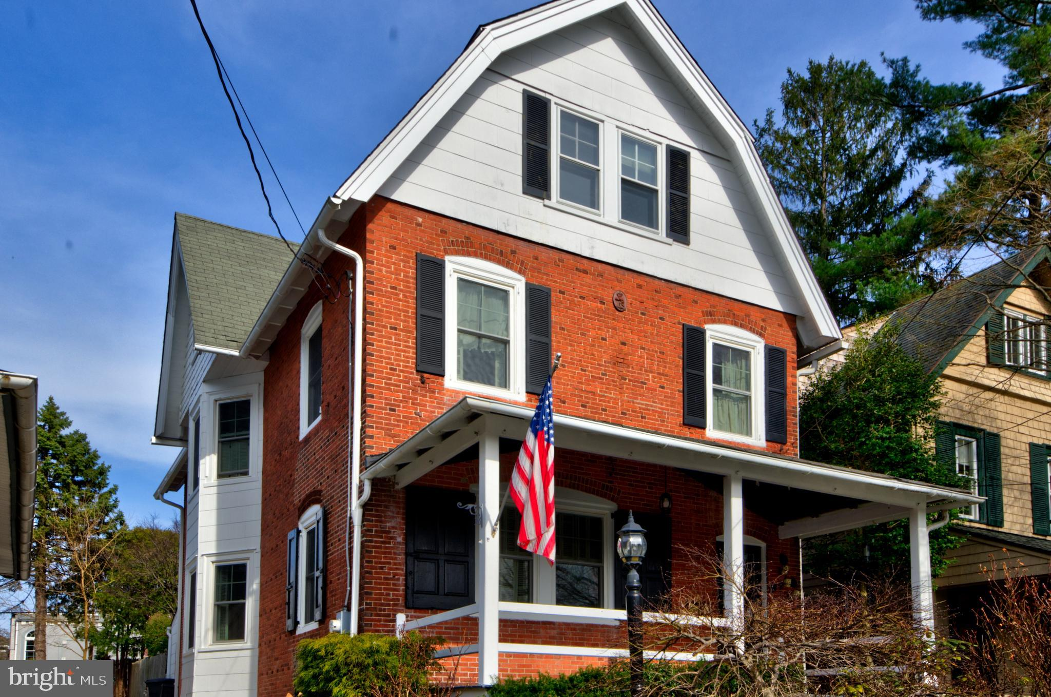 Location, Charm & Value! walk to train, walk to town. Solid brick exterior and classic front porch provide wonderful curb appeal, High ceilings, hardwood floors, spacious light filled rooms . First floor offers a welcoming foyer, formal living room, elegant Dining Room with bay window, chair rail & crown moldings, powder room and Farmhouse sized eat-in Kitchen with wood cabinetry, granite counters with an abundance of space for entertaining when all your friends wind up in the kitchen again! Just off of the kitchen a cozy Den with access to the rear patio and fenced yard.  2nd floor has four bright & spacious bedrooms with numerous windows to let in the natural light, plus a full hall Bath with tile and a pedestal sink. But Wait There's More! As you go up another flight you will find a Guest Bedroom plus a dormitory sized playroom! These 2 Bonus rooms offer a lot of options. Quiet Office space? Zoom Studio? Workout space? Au pair suite? Teenage retreat? Out of town guests? You decide! Huge Basement with loads of storage , outside exit, upgraded electric panel, Gas fired hot water heat and high Velocity energy saver air condition system makes for the best comfort in summer and winter.  Just a stone's throw from downtown Bryn Mawr's, fine dining, shopping, train lines, Bryn Mawr Hospital, colleges and more. All this in the renowned nationally ranked Radnor Schools! Just 30-40 minutes to International Airport too!