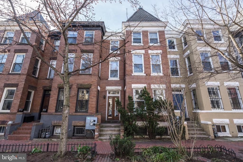 Welcome to the most romantic street in Dupont! This beautiful 5BD, 4.5BA townhome found nestled on a one way street perfectly combines two separately-metered units into a single-family home feel. The main level unit includes 2 ample-sized bedrooms, 2 full baths, an open kitchen/living/family room, an unfinished basement for storage, a washer/dryer, and small balcony.  The second unit's two upper levels boast 3 bedrooms, 2.5 baths, 9+ high ceilings, a fireplace with decorative molding and green marble, well-maintained hardwoods, a kitchen with a large family/dining room and easy access to a small balcony for morning coffee sipping.  A large private roof deck with lovely views of the neighborhood provides a cozy setting for outdoor entertainment.  The rear of the home has private parking space for 1 car.  Whether maintained together or as two separately-metered units, this townhome sits discretely within walking distance of Dupont, 17th & 18th St, and U St shops, restaurants, and Metros.