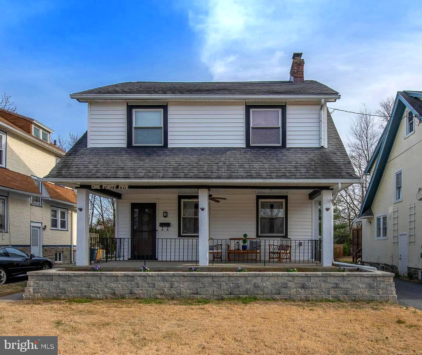 Welcome home to 145 Grandview Road, a charming completely move in ready colonial home in a great walk to everything location in Ardmore offers four bedrooms, one full and one half bath, a private fenced back yard, driveway and one car detached garage. This home has been updated throughout in the past three years. Upon arriving at the property you are greeted by a brand new stone retaining wall that provides the perfect size flower bed alongside the gated full length front porch, perfect for three seasons of enjoyment. Enter through the front door to a spacious living room with refinished hardwood floors and a stone front gas fireplace. The beautiful hardwood floors continue into the Dining Room with brushed nickel five light fixture, and is open to the kitchen with new hardwood floors. The kitchen is a cook's delight with beautiful cabinetry, granite countertops, new Stainless Appliances: GE French door refrigerator, Whirlpool Dishwasher and 5 burner gas oven with Frigidaire microwave above. A beautiful window over the stainless under mount sink with gooseneck faucet lets in abundant natural light. Conveniently located off the kitchen you will find a powder room, mudroom/laundry room with new stacked Whirlpool front loading Washer and Dryer and access to the fenced in back yard with patio and storage shed.  Take the turned staircase with neutral carpet runner to the second floor where the refinished hardwood floors continue into all four bedrooms, three with new lit ceiling fans. A lovely full bath offers a tub shower combination and vanity sink top with updated faucet and a linen closet. A door off the landing leads to a flight of stairs to the fully floored attic with tons of storage. Additional storage can be found in the basement accessed through the kitchen or a side door entry. A second laundry hook up is available in the lower level.  The Updates to this home include: 2018 full knob & tube removal and electrical system update including recessed lighting and n