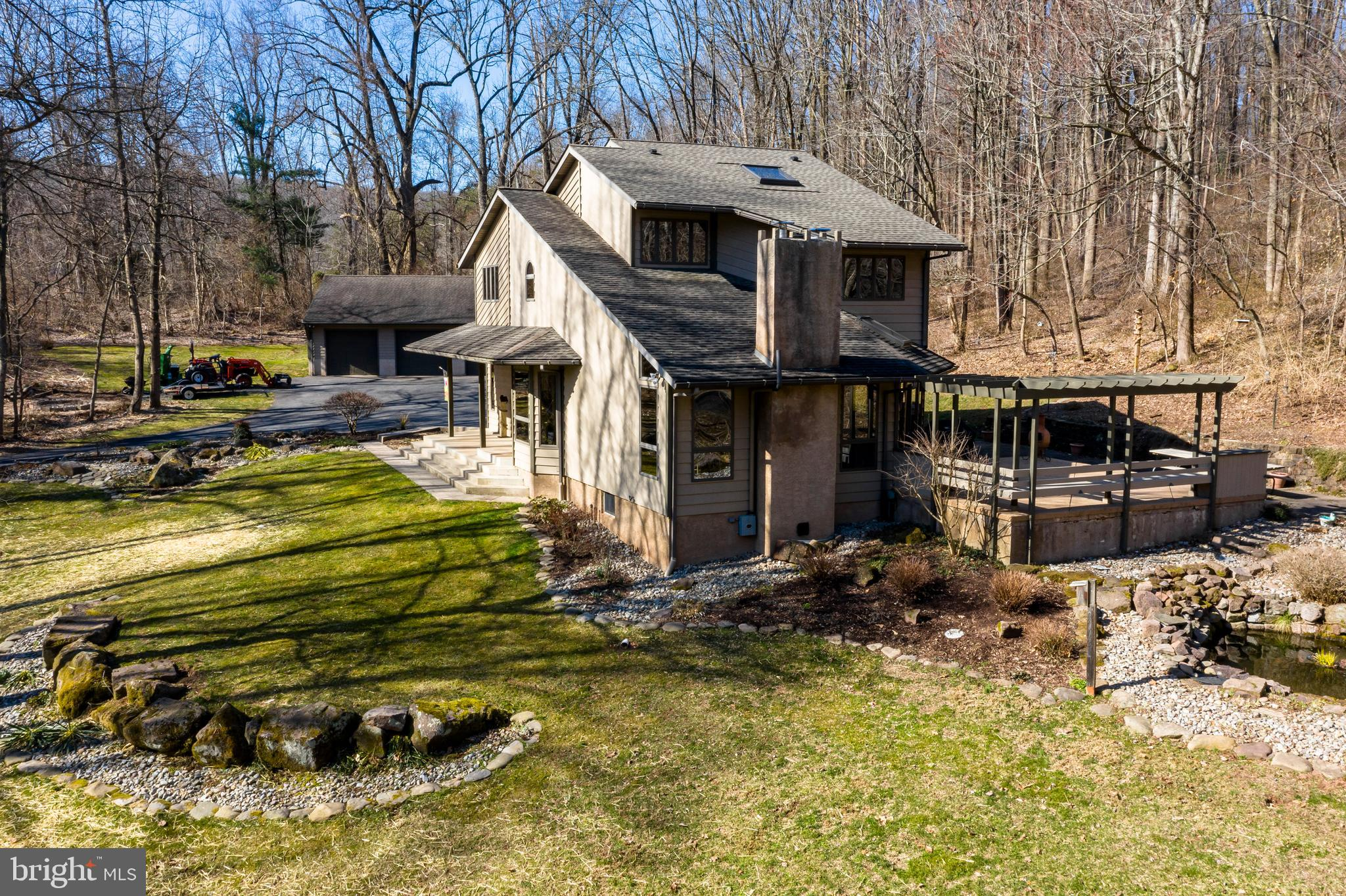 Have you been searching for your own piece of tranquility?  Offered by original owners for first time after 30 years.  This custom built contemporary home sits on 3 beautiful wooded acres in North Coventry township on Fernbrook Lane.   Enjoy watching wildlife and birds in any season.  Spring, summer and fall are perfect for sitting on back deck(complete with pergola) to soak up the peace and quiet listening to waterfall at the ornamental man-made pond. This personal oasis is within short walking distance to Coventry Woods Park and open space consisting of 688 acres of mostly mature deciduous forest!  The unique open floor plan provides abundant light throughout the 3 bedroom 2 ½ bath home in award winning Owen J Roberts SD.  Kitchen features include tile floor, deep window (great for growing herbs or flowers)  and large peninsula.  Kitchen is open to dining room and living room with hardwood floors and vaulted ceiling. Welcoming foyer with tile floor, powder room and laundry room are also found on first floor.  Main bedroom has vaulted ceiling, two large closets and full bath.  Full bath has double sinks, tile floor, built in medicine cabinets and skylight.  Two additional bedrooms, full bath and plenty of closet space can also be found on this floor.  Second floor carpet just replaced.  Central air and whole house fan available for comfort in summer months.  Wood stove in basement to supplement heat in winter if you choose.  Basement currently has small hair salon with separate outside entrance and powder room.   Easily converted to home office, workout room or that extra space if needed for family room. There is oversized one car built-in garage AND 3 car detached garage complete with propane heater and electric! All of this located within an hour from King of Prussia, Reading or Exton!