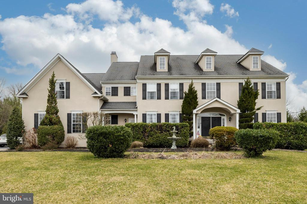 Welcome home to this beautiful executive house in the Woods Edge community located in the highly desirable Spring- Ford area school district. This 4 bedroom 4.5 bath home is sure to impress. Possible in-law suit with separate entrance. Enter through the double doors to a dramatic 2 story foyer leading to a two story family room with a floor to ceiling gas stone fireplace. There is a wall of palladium windows and 4 sliders that lead to an oversized paver patio and a huge custom heated inground swimming pool with spa. The backyard is very private and peaceful with a maintenance free fence. There is also a pool house with electric and storage. Adjacent to the gathering room is the open concept eat in kitchen with granite countertops and island seating. Leading out from the kitchen is a formal dining room with hardwood floors. There is a convenient 1st floor study/ office, living room, powder room and laundry room with separate entrance and sun porch. The 3 car garage is accessed from the laundry room. Upstairs there is a main bedroom suite with two over sized closets, a sitting room, huge bathroom with bidet, luxurious soaking tub with jets, double sinks and separate shower. There are three more good sized bedrooms. One has it's own full bath.  The other two, serviced by a hall bath complete the second floor. There is a second staircase that leads downstairs to a custom finished basement adding approx. 1500 additional square feet of living space with a custom bar with sink, hardwood and tile flooring, refrigerator, and wine rack. There is a built in 6ft hidden safe. There are two separate rooms that could be used as bedrooms with both having closets and windows. One room is currently used as a home gym. The other is used as a home office. There is also a full bath and entertainment room and double French doors with a ton of daylight and walkup entrance that leads to the backyard. HOA dues are $680 per year and include septic pumping every other year, trash removal, and