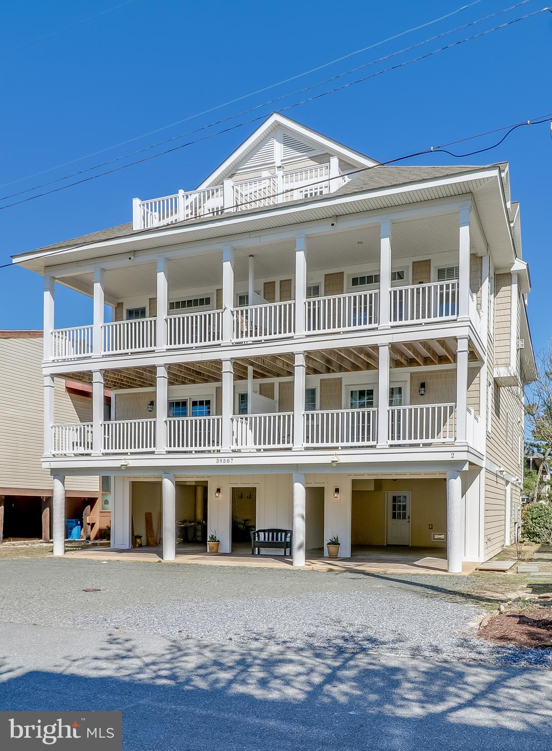 Welcome to your beach house in Tower Shores! Just steps to the beach, this east-facing duplex is fully furnished, turnkey, and ready for you. There is plenty of room for the entire family, with 4 bedrooms, 3.5 bathrooms, and a loft—you can sleep up to 12! This custom home features 3,200 square feet of living space, with each floor providing both front and back deck space which totals over 800 square feet. Details such as hardwood floors, Andersen windows, and many beautiful finishings make this house truly a home. The first floor features an entryway with closet/storage space as well as a separate closet built out and ready for a future elevator. The second floor features three bedrooms (complete with seven beds), two bathrooms, and a laundry room. As you reach the third floor, you will discover the inverted floor plan with an open and beautiful living room, dining room, and kitchen. Kitchen highlights include stainless steel appliances, granite countertops, an undermount sink, and a breakfast bar. The living room boasts a gas fireplace and looks out onto the balcony, offering views of the ocean and the bay. The fourth floor features the second owner's suite and a loft. Moreover, the en suite bathroom on this floor features a double sink and a soaking tub. This property is currently being utilized as a rental and has already been rented throughout Summer 2021. Schedule your tour of this beautiful property today!  Check out the floor plans and Matterport tour https://my.matterport.com/show/?m=e7eHVUZTdsu