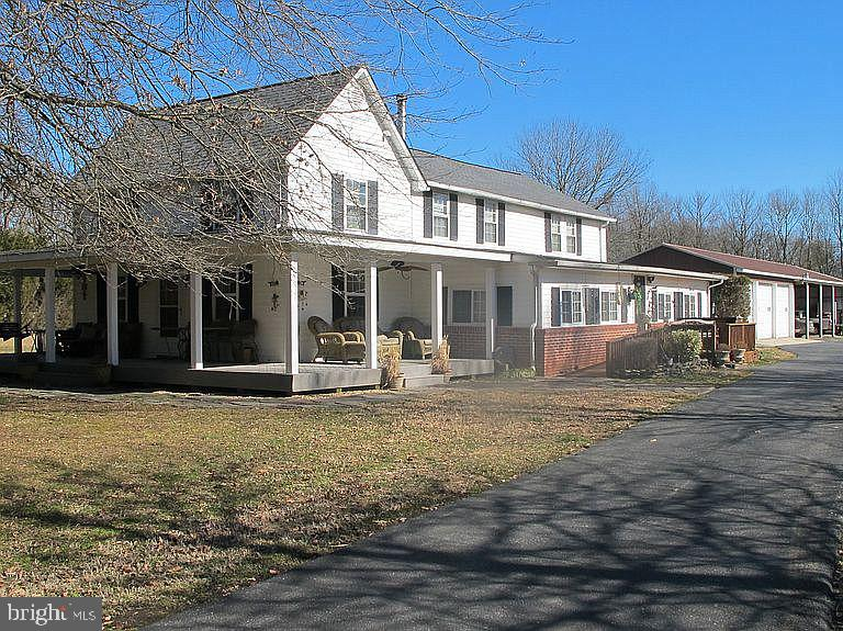 R-11764  ***** NEW PRICE!!!*****    COUNTRY LIVING AT ITS BEST!  Old style Farm home within Caesar Rodney School District  located on 10.5+ acres, 5 bedrooms, 3 bathrooms with a new roof as of 2020!   Sit on the wrap-around front porch and watch the Amish buggies go by, cool off in the pool, or relax in the hot tub watching the night stars.   Great set up for a horse property with an arena, pond accessible for animals, pasture has a covered shelter and there is walk-in barn access. 5+ acres of hay fields provide feed for your animals or potential revenue. This farm offers a 4+ stall Barn with a hay loft, 3 Car Garage/Shop & 4 Open Bays.  Property has above ground pool, pond, fenced pasture & hay fields. Dual zone heat & AC and a wood burning stove.  Property on well & septic. The property also has chicken coop, pig pen, dog kennels and garden area.  Comcast/Xfinity connected.    This property is mostly self sufficient with its well/septic & a wood burning stove making only monthly bill electric with an occasional propane fill when needed. Close to gas station & country stores and only 20 minutes west of Dover. We are also only a short mile walk to the Harvest Ridge Winery.