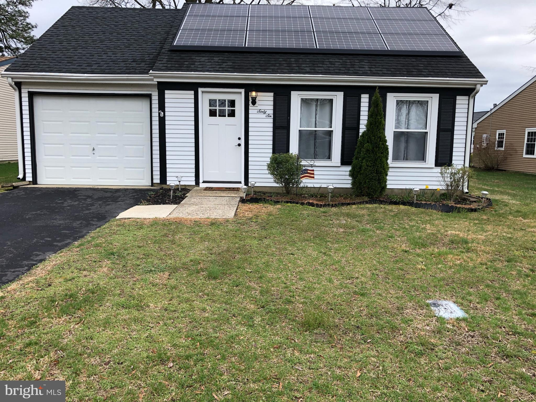 Nicely Updated Chatham Model with Solar -  2 Bedrooms 1 Bath Stainless Steel Appliances, Granite Countertops with Maple Cabinets Newer Roof and A/C Laminate flooring throughout Living, Dining, hallway and Kitchen Carpet in Bedrooms Make Appointment today  - won't last long
