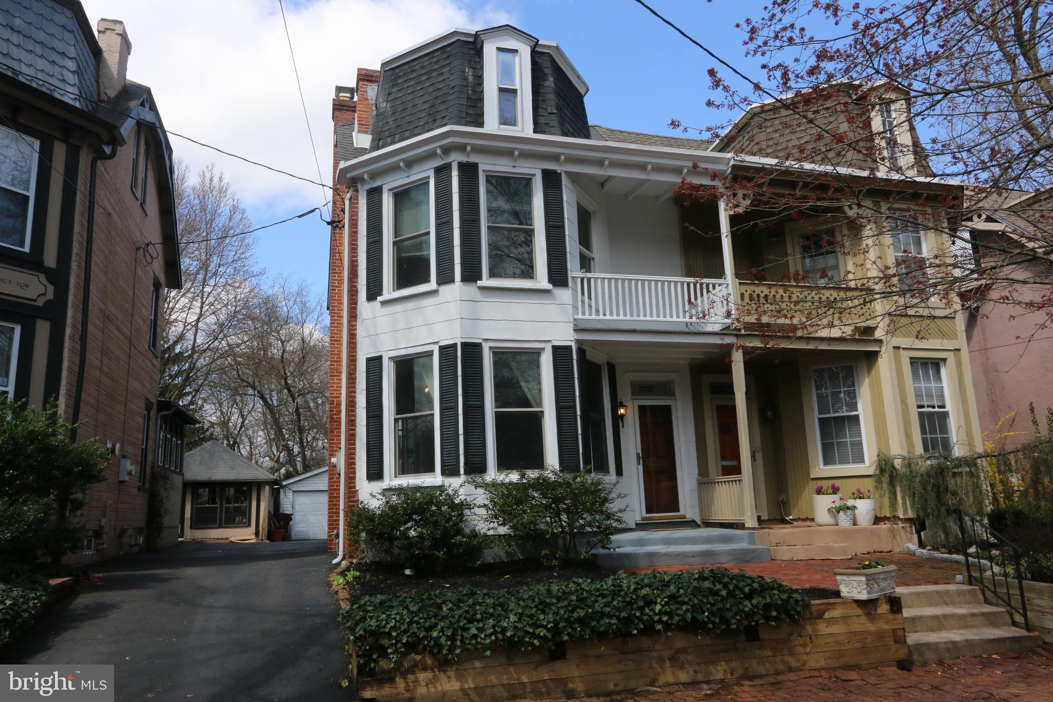 As you stroll the antique brick paver sidewalks & marvel at the turn-of-the-century architecture that welcomes you  to Trolley Square's rarely-available Mechanics Row, consider 1717 N Rodney Street. This well-maintained, three-story, semi-detached home is contiguous with the city of Wilmington's Brandywine Park, offering ease of access to recreation as well as the coveted amenities of pharmacy, grocery & nightlife.  Enter a bygone era where exposed brick walls and hardwood floors are warmed by a raised-slate hearth Fireplace, wide base mouldings are the rule, & where your Master Suite has a Master Bath, an excess of closet space and a french door that opens to a porch, enabling you to take in the sun or, watch tennis being played on nearby courts.  A Two-car, Detached Garage & driveway offer plentiful off-street parking, a rarity within city limits. Discover why Wilmington's Trolley Square is the place to be!