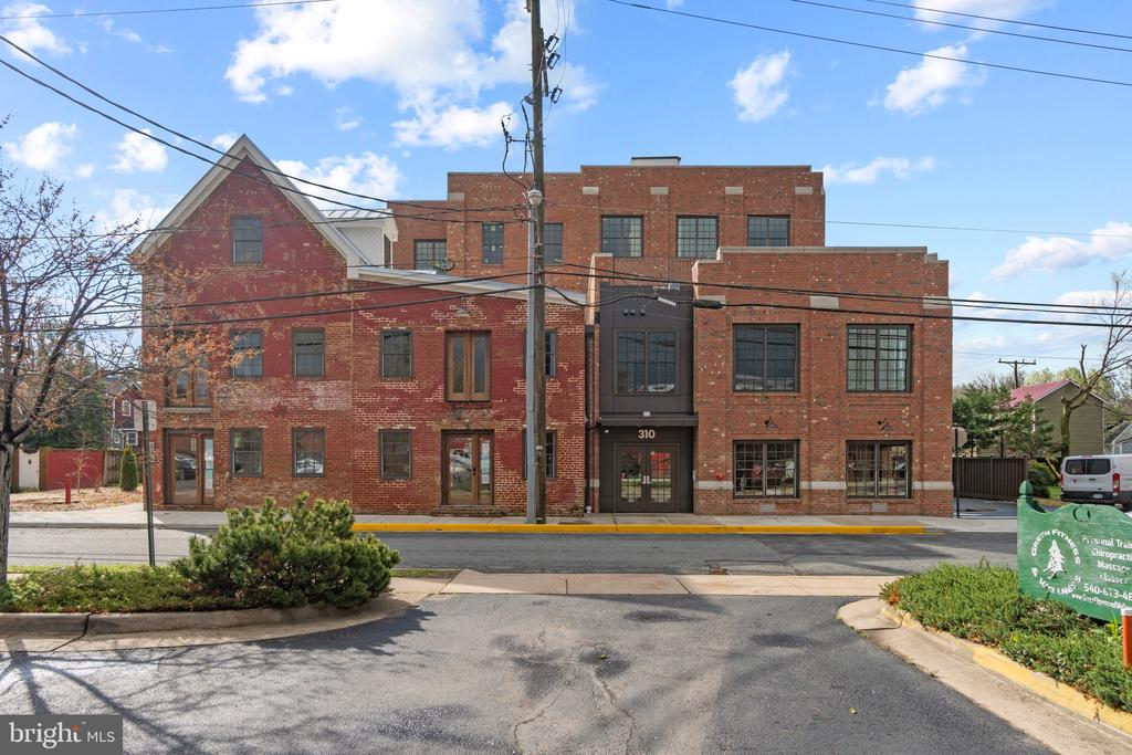 """Stunning new penthouse available in downtown Fredericksburg.  3 bedrooms. 3 exquisite full bathrooms. 1 half bathroom. 850 sq ft terrace that is fabulous for entertaining with unbeatable views of the city.  Gourmet appliances in kitchen including 48"""" Wolf cooktop and SubZero refrigerator. Quartz countertops in kitchen. Custom cabinetry throughout. 10 ft ceilings. Reclaimed hardwood floors. Full sized washer & dryer in separate laundry room.  Lavish marble master bath with full tub, separate shower and heated floors. Gas fireplace. Two private, secure, assigned, off-street parking spaces. Buyer has option to purchase private 2 car garage for a total of 4 parking spaces. Semi-private elevators. 1 Block to VRE/Amtrak station."""