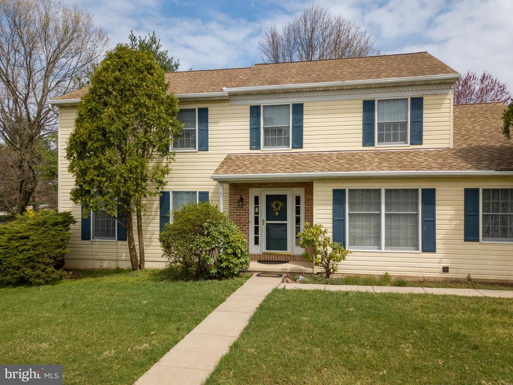 Beautiful 4 bedroom 3 bath colonial in sought after Spring Ford School District.  Upon entering there is an office to the right.  A formal living room to the left  with a bow window and french doors to the dining room with chair rail.  Then enter into the kitchen that features an island with stainless steel double sink, builtin microwave, plenty of cabinets with under cabinet lighting,  pantry, ceiling fan with light, desk area and laminate floor.  Family room has a brick fireplace with propane insert, and recess lighting.  1st floor laundry with cabinets and washer/dryer stays.  Full bath on 1st floor that leads to a 3 season room.   2nd floor main bedroom features wall to wall carpet (3 years old), vanity area with sink and main bath.  There are 3 more bedrooms all with wall to wall carpet and double closets.  Lower level  has finished basement with a pool table and accessories that stay.  Plenty of storage in front of basement along with under stairs storage.  Also a crawl space to the left s you are going down the stairs.  Electric heat, how water and central air, 200 amp electrical service.  2 car garage with lots of shelving and work benches.  Nicely landscaped rear yard with deck and a .white picket fence and a storage shed