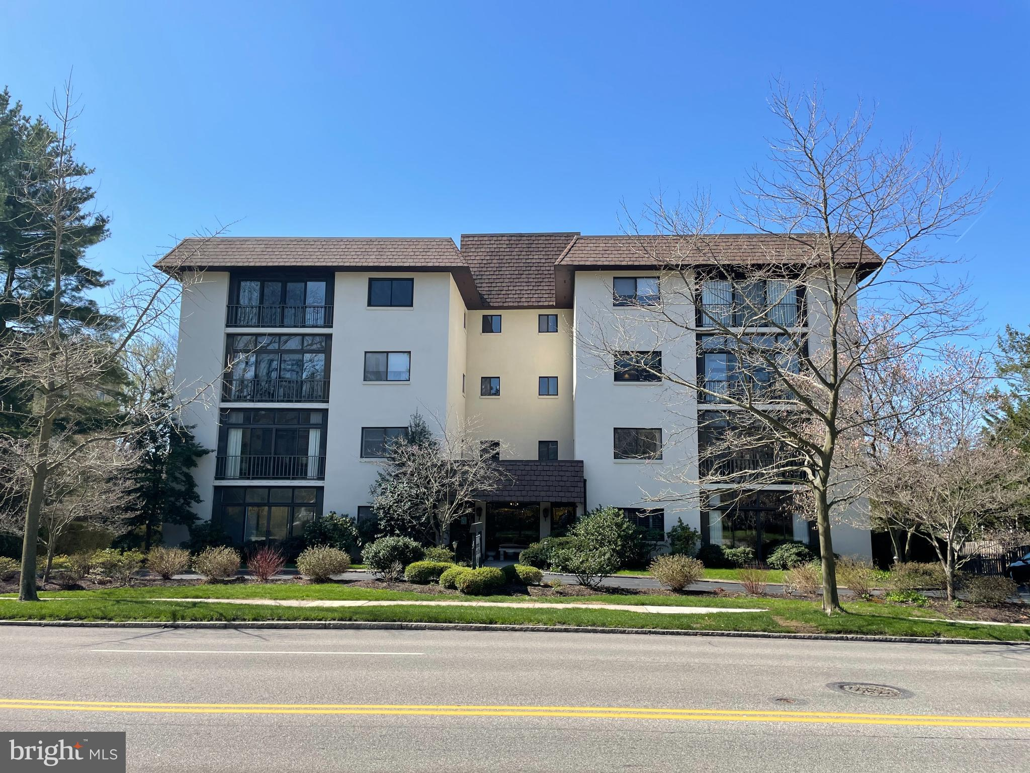 """** All offers to be submitted by Thursday April 8th by 7:00 pm .  Please use 4/8 as your acceptance date.**   Welcome to this unique opportunity to own a meticulously updated condominium at the Haverford Hunt Club. This spacious home, at 432 W Montgomery Avenue, is located within walking distance of the Haverford train station, Sharpe Park and the Merion Cricket Club.   After an elevator ride to the fourth floor, you enter this lovely top floor condo through a foyer leading to a large living area. Stunning oak flooring covers this space. Sliding doors lead to the enclosed, tile floored sunroom- perfect spot for morning coffee or evening cocktail.    Next you will find a well sized dinning room followed by a stylish updated kitchen. The kitchen design boasts custom cabinetry , Caesarstone quartz countertops, Kohler farmhouse sink, tile flooring and a herringbone tiled backsplash . A Kitchen Aide cooktop and a range coupled with a Liebherr refrigerator complete the look.    The large master bedroom is cheery and features an oversized walk in closet and renovated en suite bath, also featuring custom cabinetry and a quartz vanity top. ( All closets in the condo are professionally  finished by Closets By Design; window treatments are custom Hunter Douglas 2"""" wooden blinds.)    The second bedroom must recently served as a library/tv room complete with a wall of built in shelving. It is a perfect place to relax . The third bedroom was recently  used as an office and includes a full sized LG washer.dryer, tastefully hidden behind a red barn door .    There is also a second full sized bathroom located on the hallway near the second and third bedroom.    The unit includes a parking space in the building's parking garage  as well as a storage bin in the lower level. The parking area may be reached by Old Lancaster or Montgomery Avenue.   Haverford Hunt Club's hallways and lobby were recently renovated and serve to welcome you home to this Lower Merion gem."""