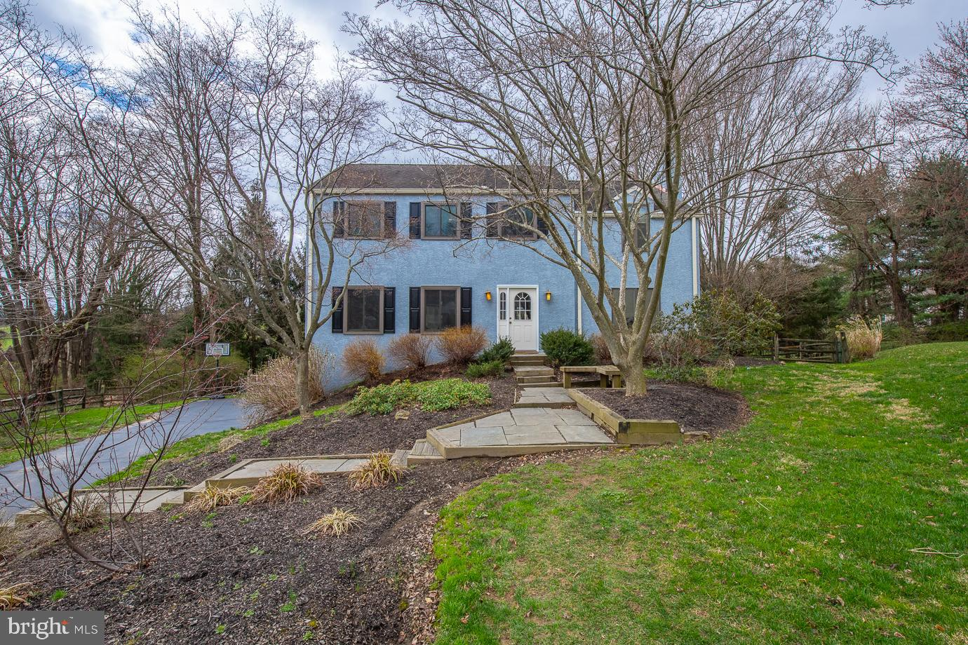 Welcome to 109 Drakes Drum Dr in the desirable Ithan Mills neighborhood of Bryn Mawr.  The sun greets you as you enter this delightful 4 bedroom, 2 full and 1 half bath, 2,784 square foot Colonial home sitting on quiet 0.43 acres.  The formal living room with crown molding and recessed lighting flows into the formal dining room with chair rail and large windows overlooking the grounds.  Conveniently located off the dining room is the large eat-in kitchen with breakfast area and sliders to back deck.  The kitchen opens to the charming family room with built-ins and brick, wood burning fire fireplace.  Also on this floor are a half bath and laundry room.   The second floor features primary bedroom with 2 large closets, window seat and ensuite bathroom.  Three additional bedrooms with full hall bath complete this level.  The walk-out lower level offers storage and additional living space perfect for playroom or gym and has sliders to patio and level fenced in yard.  Hardwood floors  and new windows throughout the home.  Two car garage.  Walk to Ithan Elementary.  Close to public transportation, 476 and the shops and restaurants of both Wayne and Bryn Mawr.  Schedule your showing today!