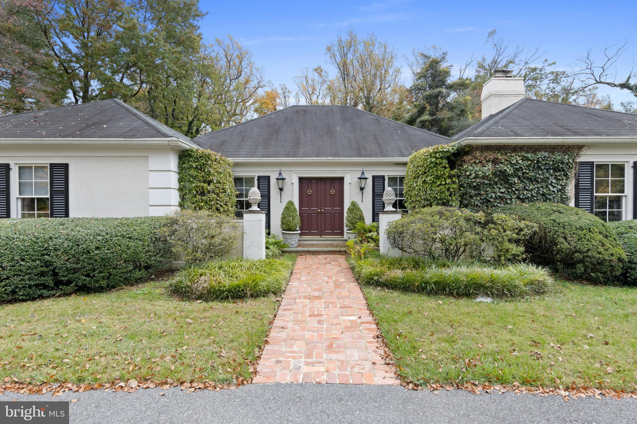 This elegant 2 BD, 2/1 BA French colonial is located on a level 1-acre property on a quiet, cul-de-sac street in northside Bryn Mawr. A transverse Entrance Hall is open to the heart of the home - a large Living Room with soaring tray ceiling and French doors to the rear Sunroom. The right side of this one-story home has a charming Family Room with fireplace, built-ins, and wet bar. This wing also has a formal Dining Room with beautiful designer finishes, well-appointed Powder Room, Kitchen with Breakfast Room & Pantries, Laundry/Mudroom, and direct access to the attached, oversized 2-car Garage. The left wing features a spacious Master Bedroom suite with sitting area and 2 large walk-in closets. You'll love unwinding in the luxurious Master BA with loads of storage, large shower, and separate jetted tub. The 2nd Bedroom has 2 walk-in closets (one cedar) and en suite 2nd full BA. Enjoy relaxing at home on the secluded brick courtyard which is accessible from the Sunroom, Kitchen, and Master BD. The professionally-landscaped property features many specimen trees, flowering perennials, and garden accents. A large grassy side yard offers ample room for recreation, gardening, or a pool. Mature perimeter plantings provide additional privacy. The lower level is partially-finished with a large Rec Room and storage abounds in the expansive unfinished Utility Room. Pre-inspected for peace of mind, this well-built stucco home has low maintenance, solid masonry construction.  A great alternative to condo and townhouse living, with wonderful potential for expansion… Open the Kitchen up to the Dining Room and use the formal Living Room as a more casual Great Room… or a 2nd floor could be added if you want more bedroom space. Minutes to shops, train, and hospital in downtown Bryn Mawr, and to highly-ranked Lower Merion schools, corporate centers, Center City and Airport.