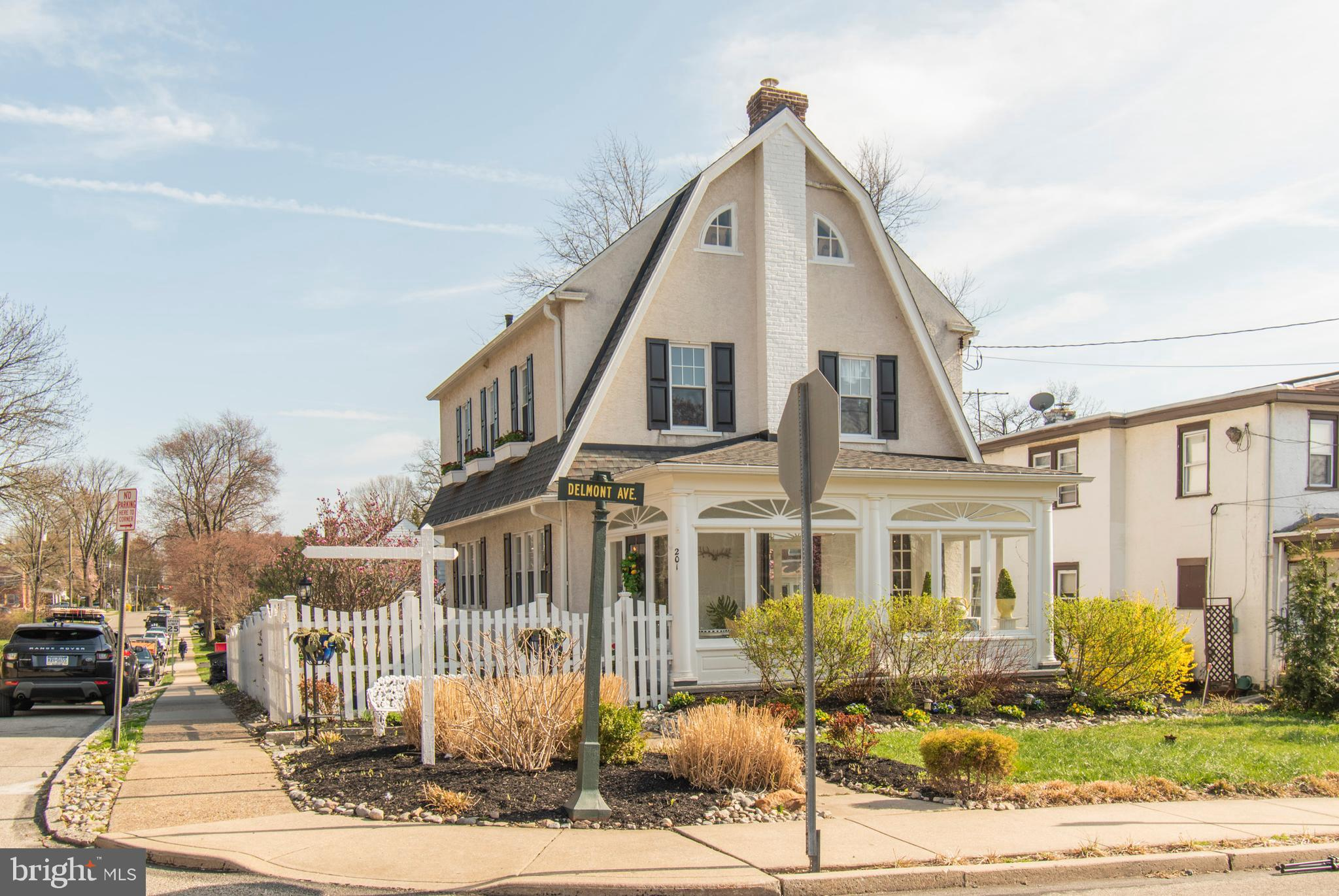 This luxurious Dutch colonial features impeccable finishes throughout, from beautiful original hardwood floors to a gorgeous antique brick fireplace. The newly updated interiors features a soft monochromatic palette and clean lines, and outside the beautifully landscaped lot is the work of art of a dedicated gardener. The spacious back patio is perfect for having a cocktail or( three )and watching the sunset after a long day at work. This perfectly located stunning Ardmore home offers both a convenient walk to everything location: Carlinos, Whole Foods, Trader Joe's, Tired Hands, Ardmore Music Hall, Suburban Square, parks and train stations  while being nestled on a quiet street.  This 5 bedroom, 2 and a half bathroom property has been loving cared for. Gorgeous hardwood floors flow throughout the sunlit home. The spacious enclosed porch with double french doors leads into the beautiful open concept living, dining and brand new kitchen space which are great for entertaining. The entire 1st floor overlooks the amazing grounds drenched with beautiful flowers.    The charming feel of the home extends upstairs to a peaceful master bedroom retreat with his and hers closets complete with updated bath and shower. The second floor features four sunny bedrooms with ample closet space and a hall bath. Completing this gem is a finished basement, which offers additional entertainment space and there is also a two car detached garage. The home is located in the award- winning Lower Merion School District and is easily accessible to King of Prussia, Center City Philadelphia, and major highways.