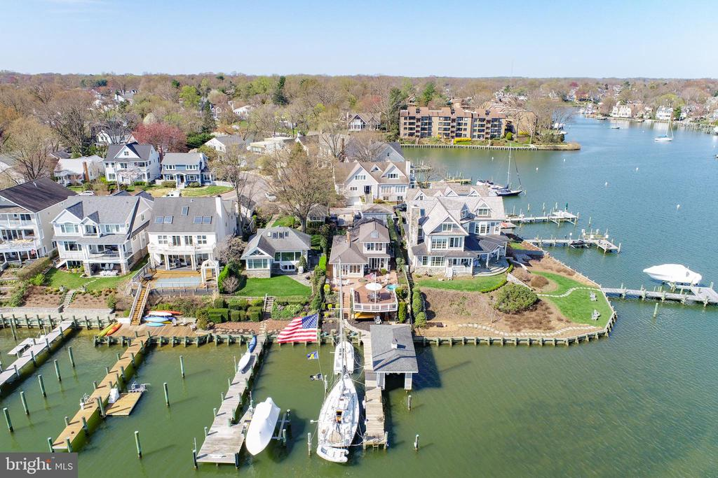 "If you want the best water view on Spa Creek, you found it here!  205 Lockwood Court is the preeminent waterfront location with sunrise to sunset, twilight to the wee-small-hours views of the beautiful Historic Annapolis skyline and Spa Creek.  Grill on the large brick patio. Relax on the expansive 20"" x 32"" deck any day or night and watch the ever-changing water activity - kayakers, paddle boarders, water taxis, .  Enjoy VIP seating, for Lights Parade, 4th of July and New Year's Eve fireworks.  Dock your boats on the 65' pier.  And the boat house!   35' x 13' with electric  lift for up to 22' x 7.7"" boat,  an automatic ""garage door"", a workshop area and safe storage.   This classic boat house is one of just a few functional boat houses in Annapolis.  The water side of the house is all windows and French Doors allowing water views from the Living Room, Dining Area, Kitchen and second-level Guest Room.  The efficient galley kitchen houses high-end appliances Miele Coffee Maker, Sub-Zero, 24-bottle wine fridge, 48' Sub-Zero fridge, Wolf Convection Microwave, Wall Oven and Range, granite countertops, unique track lighting and skylight.   Gleaming hardwood floors in the Living Room, Dining Area and Kitchen and unique beadboard ceilings original to the house.  The Primary Bedroom and Bedroom #2 are on the main level, both with vaulted ceilings, ceiling fans and skylights. Bedroom  with an expansive view of Spa Creek is on the second level.  There is a basement for your storage needs.  Parking for 2/3 cars.  Walk to Historic Annapolis and numerous restaurants in Eastport, from coffee shops to fine dining."