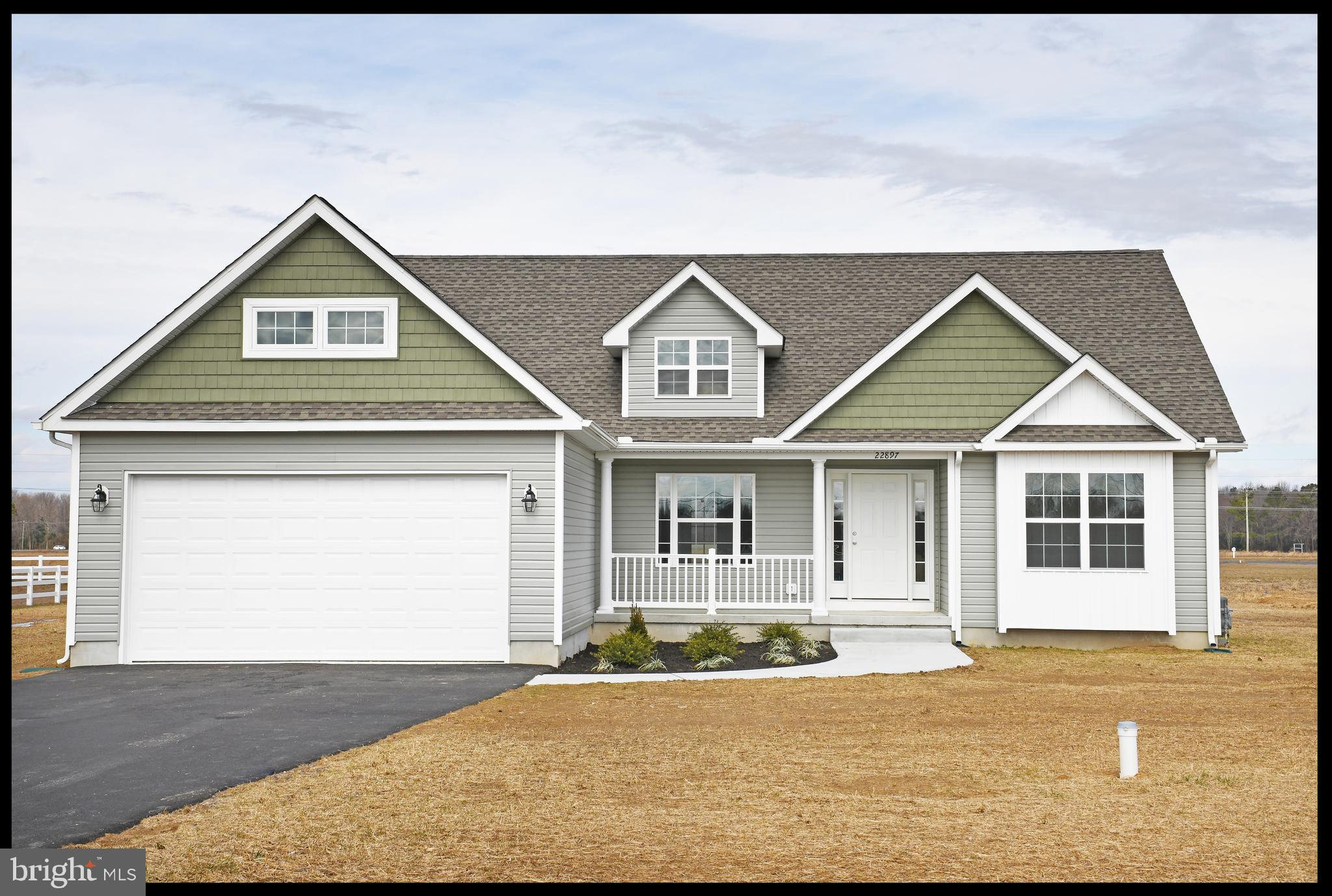 """""""The Wesley III""""  in Southfield.  Built by a local builder -Humes Construction.   This home is a split floor plan with three bedrooms and two full baths.  Open floor plan with gathering area, dining area with kitchen has vinyl plank flooring.  Kitchen with Wolf cabinets, granite, & stainless appliances.  Owners suite has full bath and walk in closet.  Two nicely sized guest bedrooms and a full guest bath.  Large laundry.  Two car finished garage.  Front covered porch; rear screened porch.  Community water, County sewer, and natural gas.  Only county taxes."""