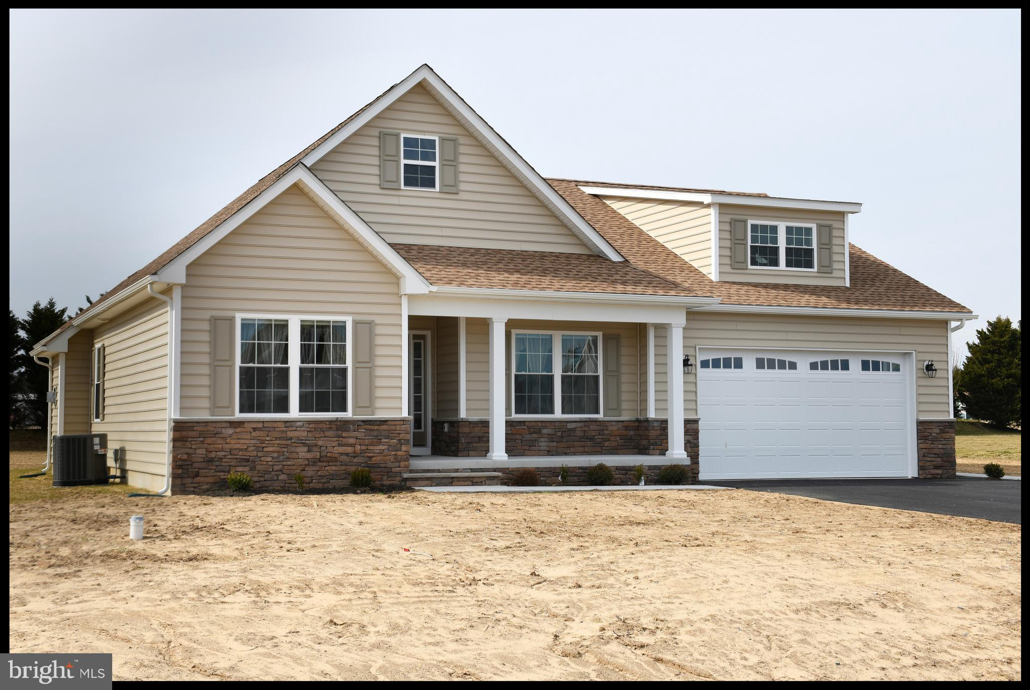 """""""The Delaware VI"""" model in Southfield.  Built by a local builder -Humes Construction.   This home is a split floor plan with three bedrooms and two full baths.  Open floor plan with gathering area,  kitchen and breakfast nook with vinyl plank flooring.  Kitchen has island, Wolf cabinets, granite, & stainless appliances.  Owners suite has full bath and walk in closet.  Two nicely sized guest bedrooms and a full guest bath.   Large laundry.  Two car finished garage.  Front porch, deck & sunroom.  Community water, County sewer, and natural gas.  Only county taxes."""