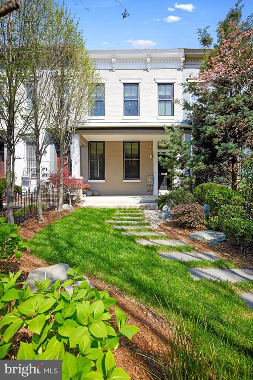 Offers (if any) are due by Noon, Wednesday, April 14, 2021. Spectacular, contemporary porch front Federal in the heart of ultra-hip 14th Street Corridor/Logan!  The home has it all:  Oversized garage with extra storage; wider than average lay-out with large living & dining rooms; kitchen with breakfast space, SS appliances, granite counters. South facing with tall windows, the home offers a sophisticated interior with bespoke Poliform bookcases & custom made staircase.  3 large BRs plus custom designed home office, 2 full BAs on 2nd level & powder room on 1st. The professionally rendered front & back exteriors are beautifully imagined with artful hardscaping and carefully selected landscaping. Awesome walk score of 100!