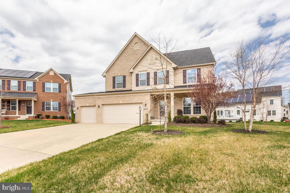 Gorgeous Colonial on a desirably tranquil cul de sac in the Fairwood community!  Harwood floors in foyer with 9 ft ceiling.  Wood blinds.  Dining room with chair railings and crown moulding.  Family room with floor to ceiling raised hearth fireplace.  Den/office/library room.  Morning room with vaulted ceiling and exit to deck with built in lights.  Kitchen with gas range, stainless steel appliances, 42 inch cabinets, recessed lights, ceramic tile backsplash and walk in pantry.  Fully finished basement with wet bar, rec room, media room, bonus room, storage, full bath and private exit.  Four bedrooms, two baths and loft upstairs.  Luxury owner suite with ceiling fan, oversized closet and attached spa bath with granite dual vanity.  Coveted bedroom level laundry.  Three car garage.  Must see!