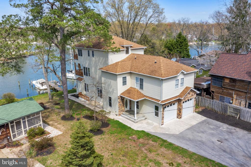Open House Saturday 4/10 1-3pm * Waterfront Living at it's finest in Severna Park * Deep Water with Private Pier on Cypress Creek * This home features 6 Bedroom 5 Full Bathroom and 2 Half Bathrooms, Re-Built in 2009. Open Floor Concept with gorgeous water views and decks on every level, gourmet chefs kitchen with stainless steel appliances and ample counter space, hardwood flooring throughout entire house, each bedroom features a private bathroom, owners suite with 2 walk in closets and walk in shower with soaking tub with water views, 2 car attached garage and separate building that could be a cottage or office. See Pics and videos.