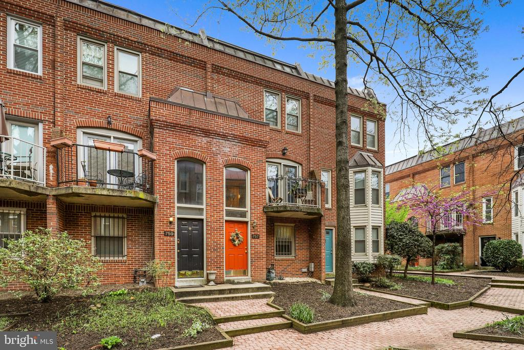 This inviting and spacious row house is located in a private gated community and is tastefully appointed and is located just steps from the popular H Street corridor.  The stately brick exterior with a bright and cheery door welcomes you home. Upon entrance, you will be greeted by a two story foyer with a bedroom located  on the first floor. An exposed brick wall in the living room serves as a focal point for the main level. The gleaming hardwoods lead into the upgraded kitchen with granite counters and stainless steel appliances. A half bath and open concept dining space round out the main floor. Upstairs, you will find two bedrooms with hardwood floors and each with their own updated full baths. This home is wired for ceiling fans, boasts an intercom system and has new ductwork throughout.  Enough parking for 2 cars - attached garage & driveway. Restaurants, Walking distance to Union Station & US Capitol, and low maintenance living!  Don't miss your opportunity to make this your new home!
