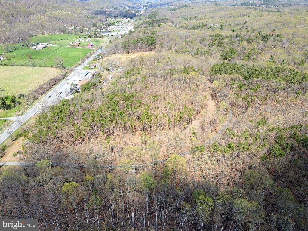31 Unrestricted Acres along US Route 522.     LOCATION, LOCATION, LOCATION - Commercial - Residential  OR Both - You decide!  536+ feet of road frontage along busy US 522.   Public water and sewer available.  The property already has a driveway installed and is ready for you to build.