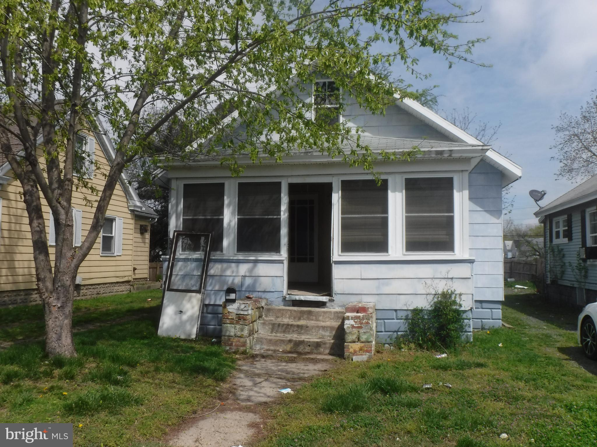 Looking for an investment?  This little bungalow  could be it!   Needs work but could be a nice income producer.  Has replacement windows, on demand water heater, large shed and off street parking.