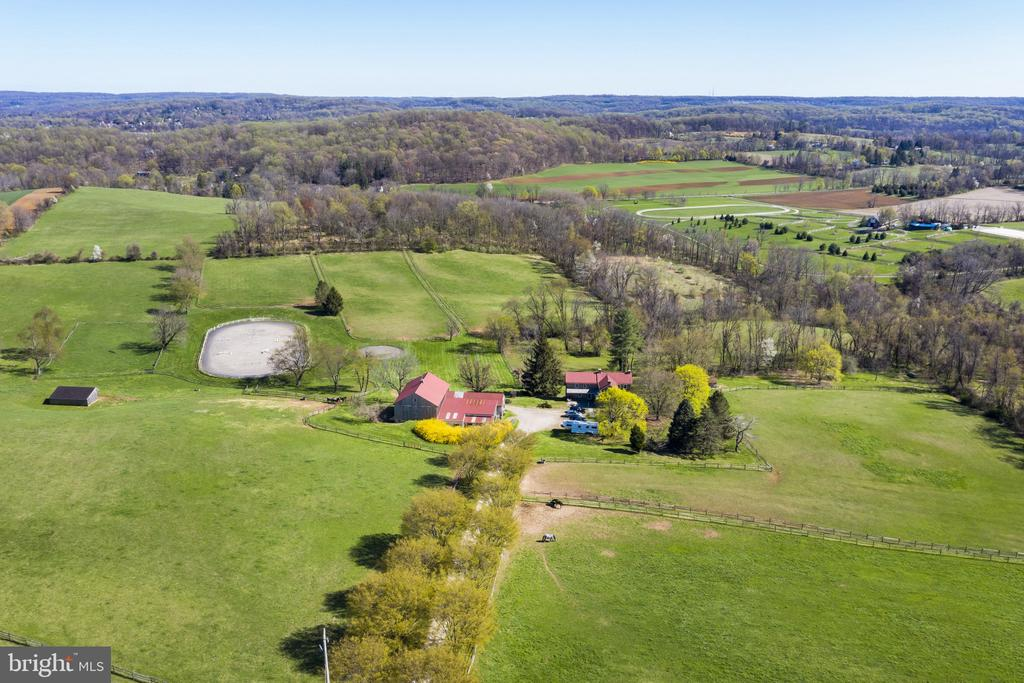 Burning Tree Farm is nestled in the hills of Chester Springs creating a real sense of place and privacy. This farm is situated on 35+ acres and surrounded by 100s of acres of land protected by conservation easement and nearby Bryn Coed Farm. Featured on the farm is an 18 stall barn, fenced in pastures, a 150x325 riding ring, and many acres for outdoor living. The 1800s home features 4 bedrooms and 1 1/2 baths, an open kitchen, beautiful dining and living room with Wharton Esherick woodwork and staircase. In addition to the interior; there is a lovely porch located on the front of the house that faces pastures and woods; creating a space to escape and unwind. Come and enjoy this remarkable farm which will be cherished for generations,