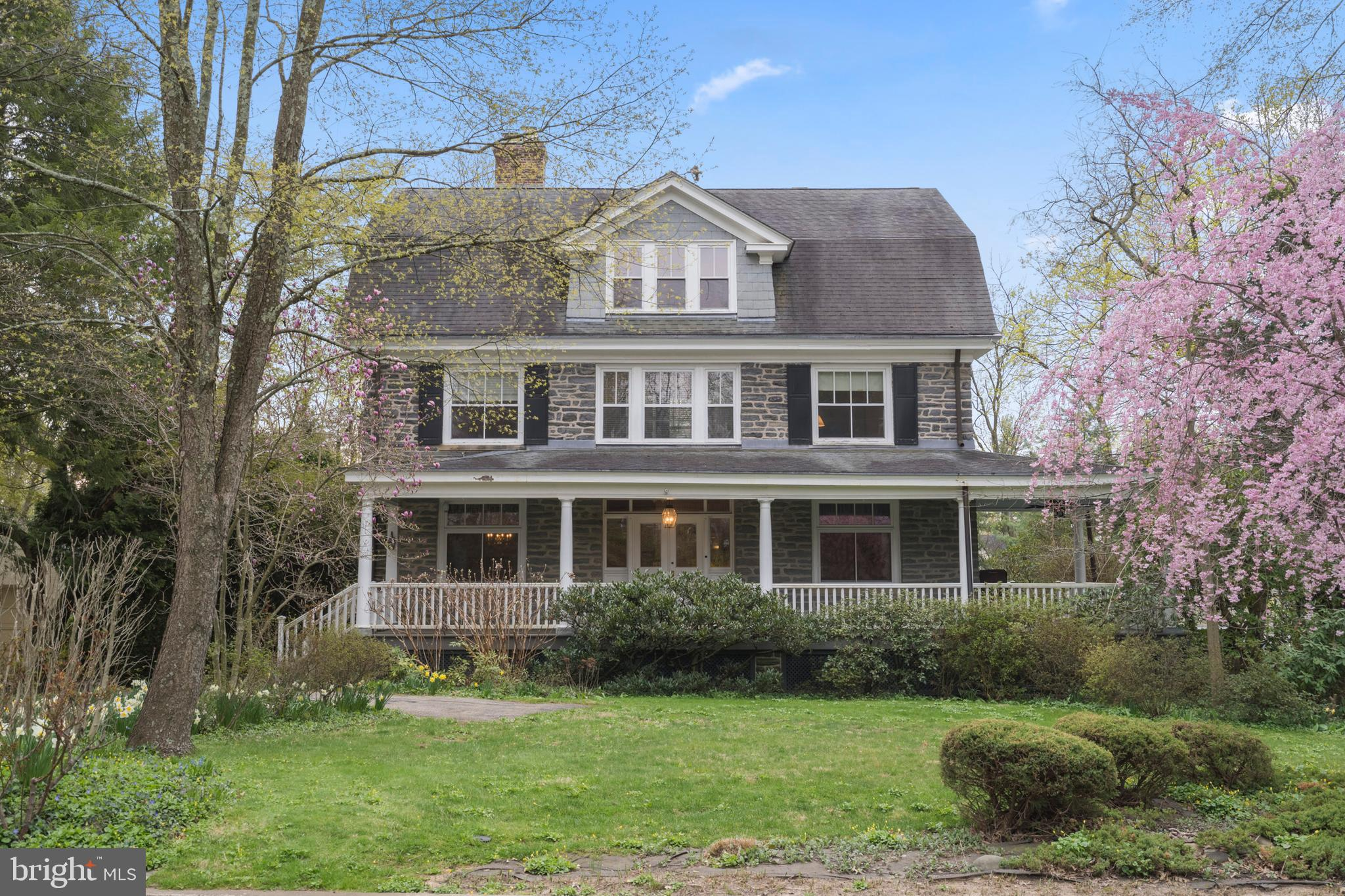 "Here is your opportunity to own a Fabulous Queen Anne stone colonial in a ""walk to"" location.(Haverford College, R-100, R-5, Haverford Square).  Have a porch party on this wonderful wraparound porch.  Enjoy the  premier plantings throughout the landscape year round.  The period double doors welcome you to the Foyer;  you notice the grace and beauty of the staircase.  Huge windows provide amazing light throughout the home.  To the right is a front to rear living room w/window seat and  offset fireplace.  To the left is the dining room with built in cabinet and fireplace. Behind the DR is the kitchen with breakfast area. The laundry, mudroom, storage and outside exit to driveway and 3 car garage is just behind the breakfast area.  The kitchen has great counter space and a cook's layout. It opens  to the family room with built-ins.  Also from the kitchen is access to rear stairs and the center hall. From there you can go down to LL and basement. Back to the front door and up the beautiful stairway to 3 full bedrooms.  The owner's suite with fp, 3 closets including 1 large walk-in closet, sitting room and private bathroom.  There is a second large bedroom with sitting room attached and built ins. The hall bath bath is generous and serves the other 2 bedrooms on the second flr.  The large 3rd bedroom is currently used as an oversized office. This room has a beautiful fireplace.  All have amazing light. Up the wide and gracious stairs to the third floor which has high ceilings and you  find 3 more bedrooms and a bath. One bedroom has incredible light and was at one time used as an art studio. It has a utility sink.  Lots of closet space in these third floor bedrooms. The current owner added a generator just last year behind the detached 3 car garage.  The home needs to be renovated, but with some work, it will be the gem of Haverford!  Open Sunday 2-4. First showings begin Saturday, April 17th at 10 am."