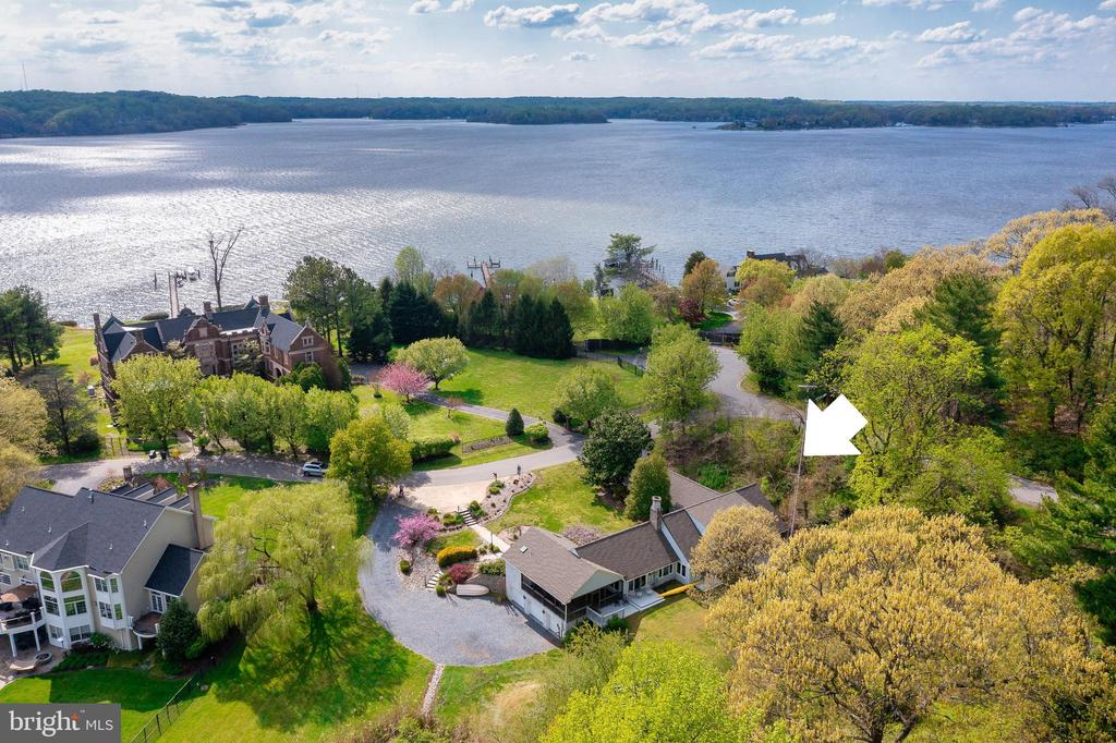 A truly exceptional opportunity in Wroxeter-on-the Severn, one the most prestigious and desirable communities on the Severn River.  This charming brick home was the Headmaster's residence for the former Wroxeter School which stands prominently across the street.  Enjoy captivating views of nearby Asquith Creek and the Severn River from this picturesque 1.42-acre corner lot.  Just down the block within a short walk, one can quickly access the Wroexeter community marina, where deep water slips (8 ft mlw) on protected Asquith Cove are available for community members.  The 3,200+ sqft home features 3 bedrooms, 4 baths, 3 car garage plus two fireplaces and the highly coveted main level owner's suite and office.  Custom built-ins throughout the help to maximize the space and the updated kitchen connects to the light-filled breakfast nook.  This home is totally turn-key and move in ready.  Alternatively, this site could also be a fabulous location to build a new custom home.  Located in the Blue-Ribbon Severna Park School district and just 5 miles to downtown Annapolis and Severna Park.  The scenic B&A Trail is .5 miles just up the street.  Don't forget to bring your boat!  Your fellow mariners will be envious of the close proximity from your doorstep to some of the best boating/fishing/entertaining the Chesapeake Bay and its waterways have to offer.  Convenient to Baltimore, BWI, Ft. Meade/NSA and Washington, DC.  You literally have the best this region has to offer in a 30-mile radius.  If you are looking for a property with water views, deep water access and a great neighborhood setting, this is absolutely the best value on the market!  To explore the property without leaving your home, be sure to view the HD Video Tour: https://youtu.be/quGtryevFpQ