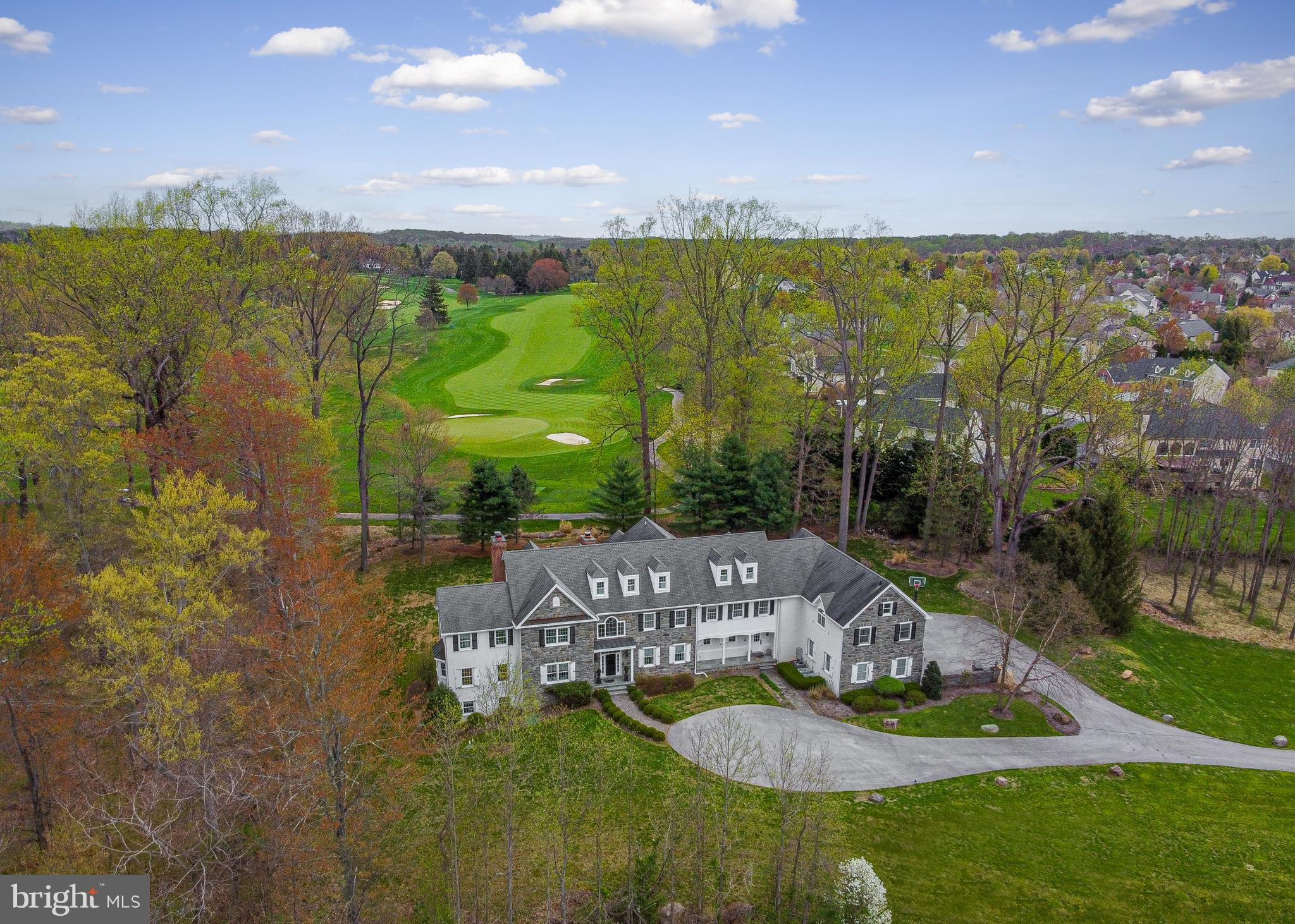 Overlooking Waynesborough Golf Course, this custom-designed and built home sits on 18 acres and maximizes the breathtaking views from every window. Located at the end of a private lane, 2291 S Valley Rd offers over 12,000 of living space on 4 levels. No expense was spared in building this home as evidenced by exquisite details throughout including curved archways, custom moldings, coffered ceilings, tray ceilings, stone feature walls, custom built-in cabinetry, oversized windows, and site-finished hardwood floors. Enter through a grand 2-story foyer that extends from front to back showcasing the stunning view from the moment you walk through the door.  The living room, with a herringbone pattern floor, fireplace and window seat connects to a private study with built-in cabinetry. Opposite the living room is the dining room, with classic wainscotting, and access to an amazing butler's pantry and bar area which connects to the gourmet kitchen.  The breakfast room with sliders to the patio opens to the 2 story family room all with golf course views and natural light.  A mudroom with cubbies and two powder rooms complete this level. Upstairs, the second level includes the generous master suite with fireplace, tray ceiling, large walk-in closets and spa-like owner's bathroom. Four additional bedrooms, 3 full bathrooms are also located on the second floor.  Not to be missed is the oversized bonus room with a volume ceiling which can make a perfect playroom, game room or with the 3 built-in desks, a virtual learning space. An au-pair/in-law suite with a full kitchen, bedroom and bath are found off the bonus room and rear stair.  The finished third level offers so many possibilities - a recreation room. private suite or whatever you might need!  The finished walkout basement rivals any finished basement on the market. A full pub-style bar, wine cellar, exercise room, sauna, full bath, billiards room, family room with fireplace and sunroom, this space has something for every