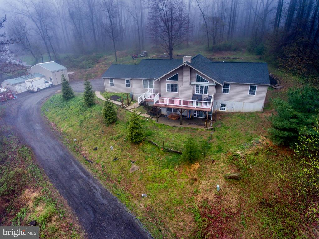 SHOWINS BEGIN SUNDAY APRIL 18...Welcome to 3494 Conestoga Rd, a custom built 4 Bedroom 3 Bath, 3600+ square foot open concept home on almost 4 acres. Bring the entire family, and enjoy the privacy and picturesque grounds. This Chester county  beauty is minutes from state and county parks, and a short drive to shopping, entertainment, and top quality schools. In addition, the property boarders a Nature Conservancy, and is just a stones throw from Route 100 and the PA turnpike. If you enjoy entertaining, this is the one for you, inside and out. The secluded back yard is great for gatherings or just hanging out and enjoying the trees and wildlife. The home has just been freshly remodeled, new paint and flooring throughout, new kitchen and bathrooms all in 2021. The 1000 gallon propane tank (owned), operates the stove, clothes dryer, heater, 80 gallon hot water heater and both fire places. The main floor consists of a central great room, open concept kitchen/dining area, with a propane fireplace. The is the heart of the house, where everyone can be together. Directly off the great room is the master suite, including the private full bath. The other 2 bedrooms are on the opposite side of the great room, with a full hall bath. Rounding out the main floor is the laundry/mud room, and a pull down attic stair leading to the floored storage space. The lower lever can be entered by 2 different staircases, or a walkout ground level slider. The huge walkout lower level consists of a large family room with propane fireplace, and exercise room. Continue down the hall to the office, 4th bedroom and hobby room (could be used as a 5th bedroom). In addition to all this there is more storage space/ utility area. Add in a 2 car attached heated garage, a front deck, back patio for that morning coffee and this one has it all. Finally the storage/ large workshop for tools or toys, you really need to see this one in person. Hurry, schedule a visit,  before it too late.