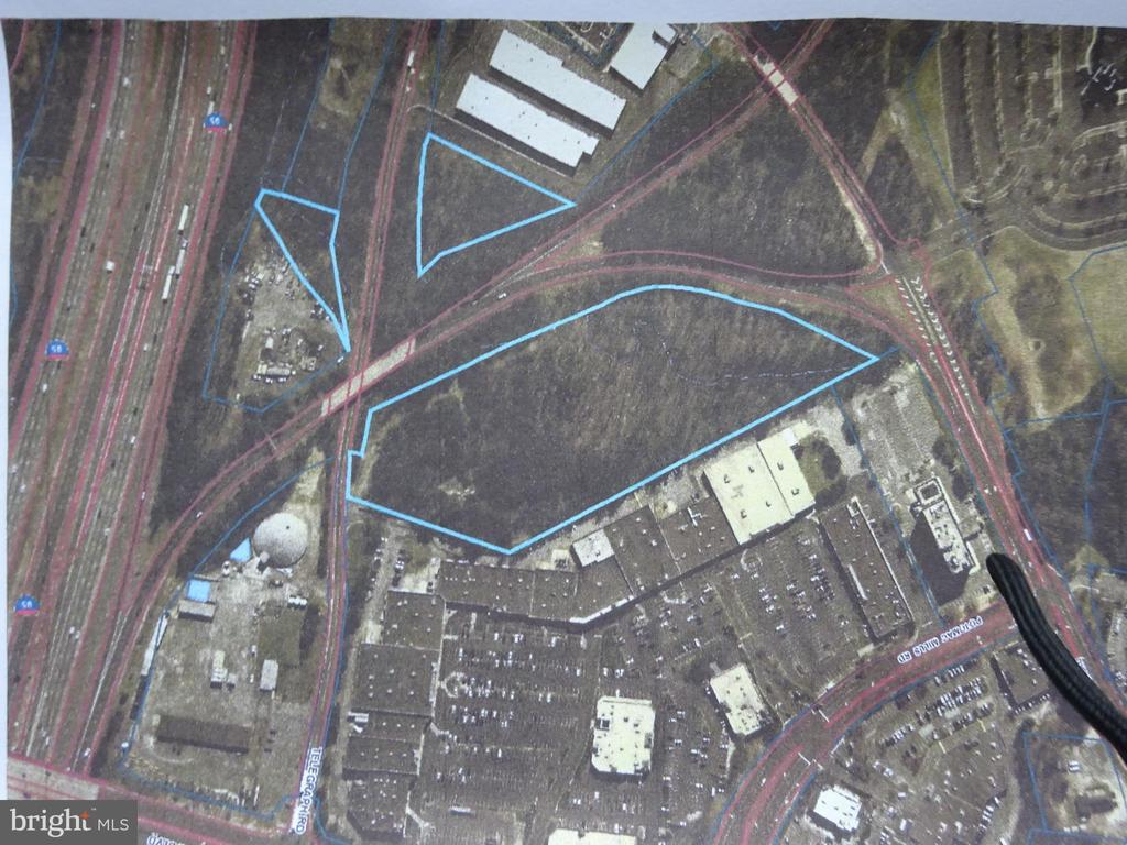 LOCATED ACROSS FROM POTOMAC MILLS MALL. BEHIND POTOMAC MILLS FESTIVAL SHOPPING CENTER AND STAPLES OFFICE SUPPLIES. ALMOST 11 ACRES OF PRIME RAW LAND MOSTLY WOODED CURRENTLY MIXED ZONING. EASY ACCESS OFF OF I-95 AT EXIT 156 B. THIS PROPERTY IS IN THE BUSIEST SECTION OF WOODBRIDGE SURROUNDED BY SHOPPING MALLS, HOTELS, MEGA CHURCHES, OMNI COMMUTER BUS TERMINAL, RESTAURANTS AND IS A PRIME LOCATION FOR ANY COMMERCIAL OUTLETS OR INVESTORS.  NO APPOINTMENTS NECESSARY, YOU MAY WALK THE PROPERTY.
