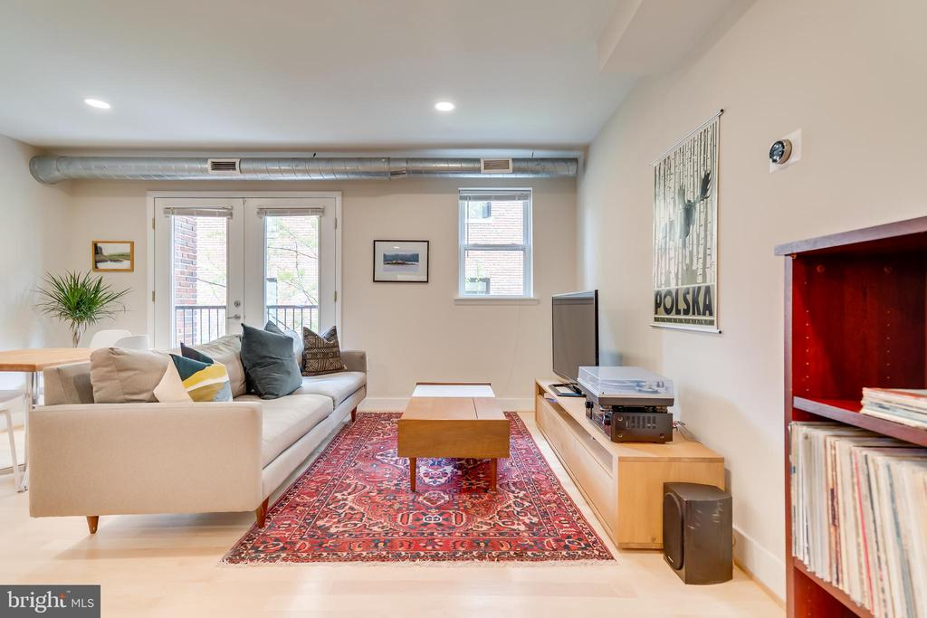 McGill Row Condo in Bloomingdale | 2 Bed | 1 Bath | 880 Sf | Juliet Balcony w/ French Doors | Building: Boutique Building, Renovated in 2012, 19 Units, Central Entry Courtyard, Secured Access | Unit: Open Layout w/ Combined Living & Dining Spaces, Large Windows w/ Ample of Light, Natural Hardwood Flooring, Exposed Duct Work, Recessed Lighting, Plenty of Storage, Nest Thermostat, Washer & Dryer | Kitchen: Bar Height Kitchen Island w/ Storage & Seating for 4, Dark Maple Hardwood Cabinetry w/ Under Cabinet Lighting, Granite Countertops, Double Door Refrigerator w/ Water & Ice Dispenser, GE Stainless Steel Appliances, Double Basin Stainless Steel Sink, Miele Dishwasher | Bath: Large Granite Topped Vanity w/ Storage, Tile Shower Backsplash & Flooring, Full-Size Tub