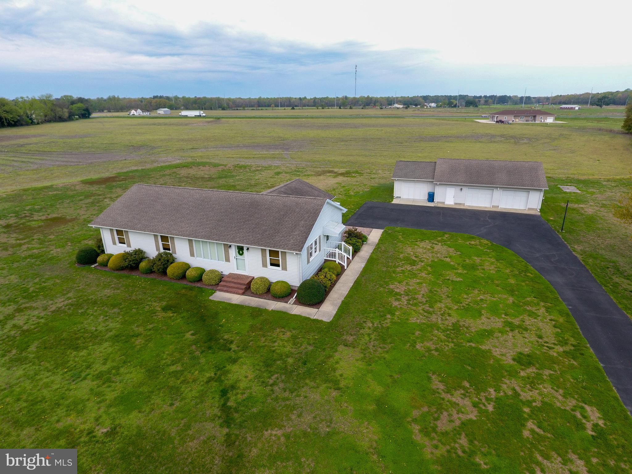 Beautifully maintained one story rancher on a level two acre lot!  Pride shows throughout this home.  Home has a nice sized family and living room to enjoy.  Laundry/Mud room right when entering from the side door.   Owner's bedroom has it's own bathroom with shower.   Owner combined two bedrooms into one large bedroom with numerous possibilities.  Back of the house has a  14 x 20 sun room! Outside the sunroom is a brick paver patio to enjoy in the mornings and evenings.  You will love the three bay oversized garage with workbench and ceiling fans!  All three bays have electric door openers.     Come check out this beautiful home! Septic system failed and seller is in the process of obtaining permits and replacing the system. Furniture in home is available for sale on a separate bill of sale.   Dining room set, trunk in large bedroom not for sale, and trailer in garage are not for sale.