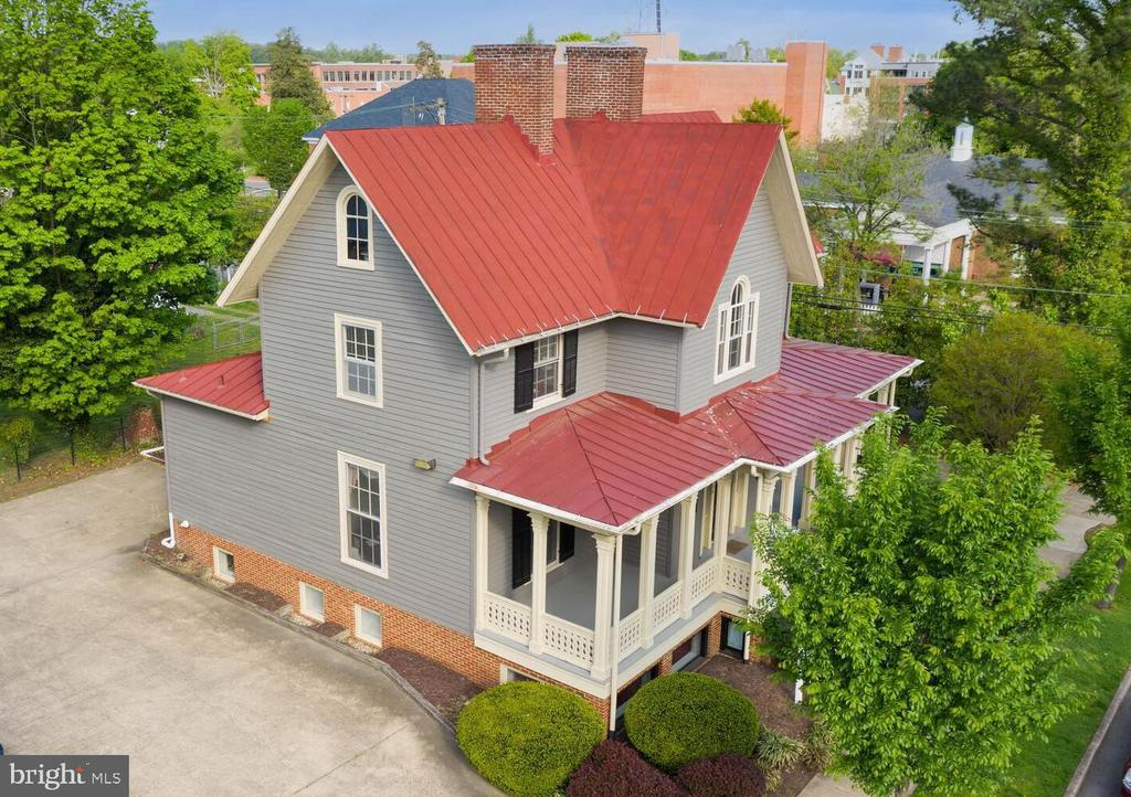 """This unique and beautiful William J. Chewning House is looking for new owners and what a story it has to tell!  """"Shadow Lawn"""" was constructed in the mid-late 1800s in Gothic Revival Style and originally stood at 408 George Street.  From 1929 to 1937 it housed the private American Civil War Collection of Dr. Chewning and was known as The National Battlefield Museum.  In 1984, the home was relocated to its current location at 804 Charles Street.  It is zoned as Commercial Transitional (CT) and is currently configured for four Business tenants and one Apartment. The entry-level has 3 professional-sized offices and a private bath (leased as one unit).  The top floor has two professional size offices, one assistant office, and a private bathroom.  The English basement is divided in half: 1/2 has one professional office an assistant's office and a private bathroom. The other 1/2 has two professional size offices, an assistant size office, and a private bathroom.  The basement also has a common kitchen and a common waiting area.  City Zoning has approved this property for a variety of housing types (with proper permits), including Duplex, Live/Work Unit, Townhome, Single Family Detached, Dwelling Unit over a Non-Residential use.  So many possibilities...make your vision a reality!"""